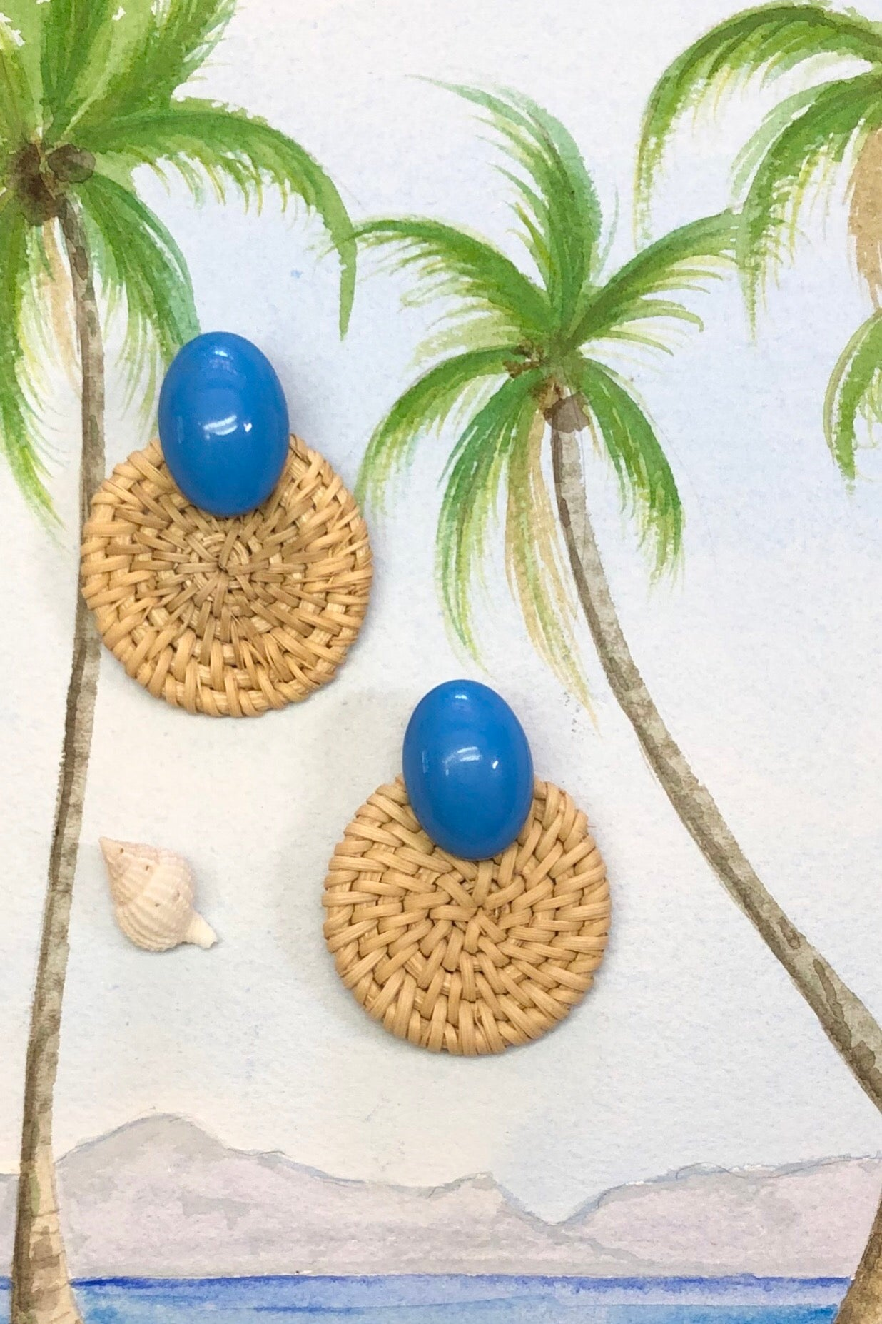 Rattan circle earrings with a splash of blue.