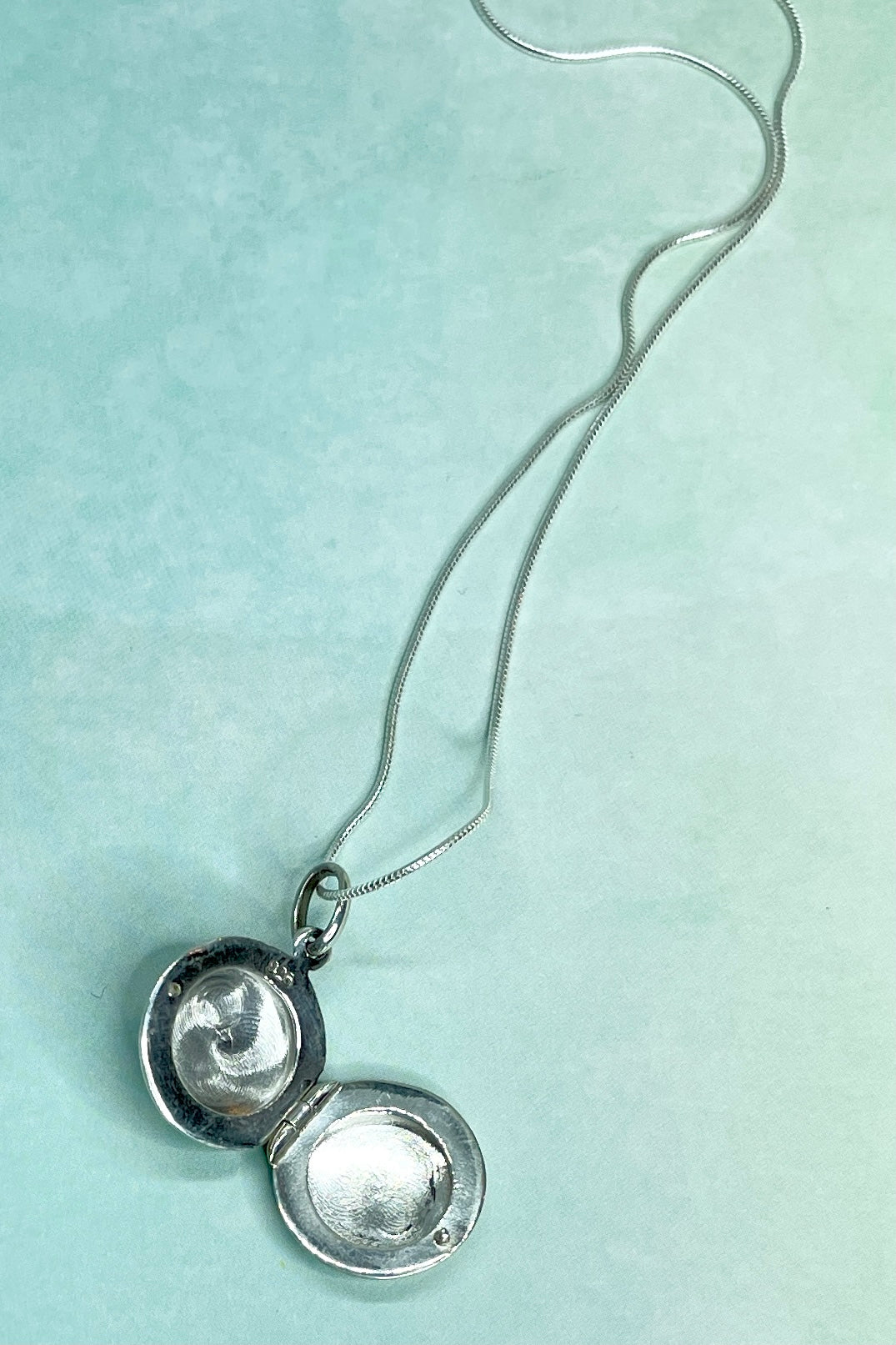 Keep your secrets or loves in the Pendant Locket with Black Stone. It opens to allow you to pop in pics