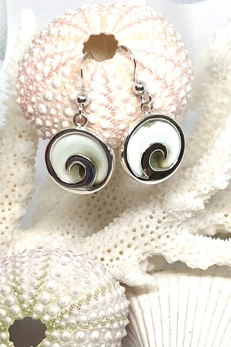 Shiva Shell is sometimes called Pacific Cat's Eye, the Earring Cay Shiva Shell features approximate 1.5cm in length, 925 solid silver surround and hook, delicate little round shiva shell design.