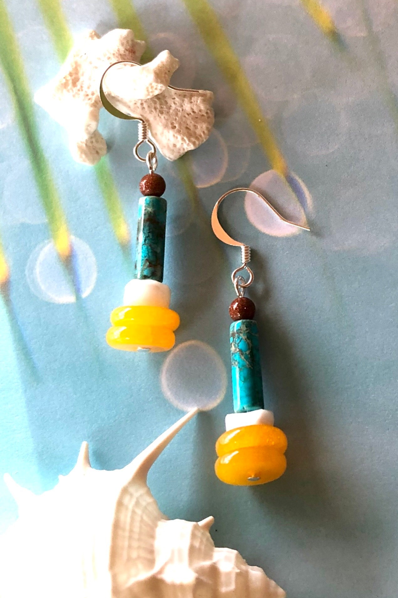 Samara May Moment earrings are handmade drop style earrings featuring turquoise howlite, shell bead, sunstone, quartz and those stones are village cut.