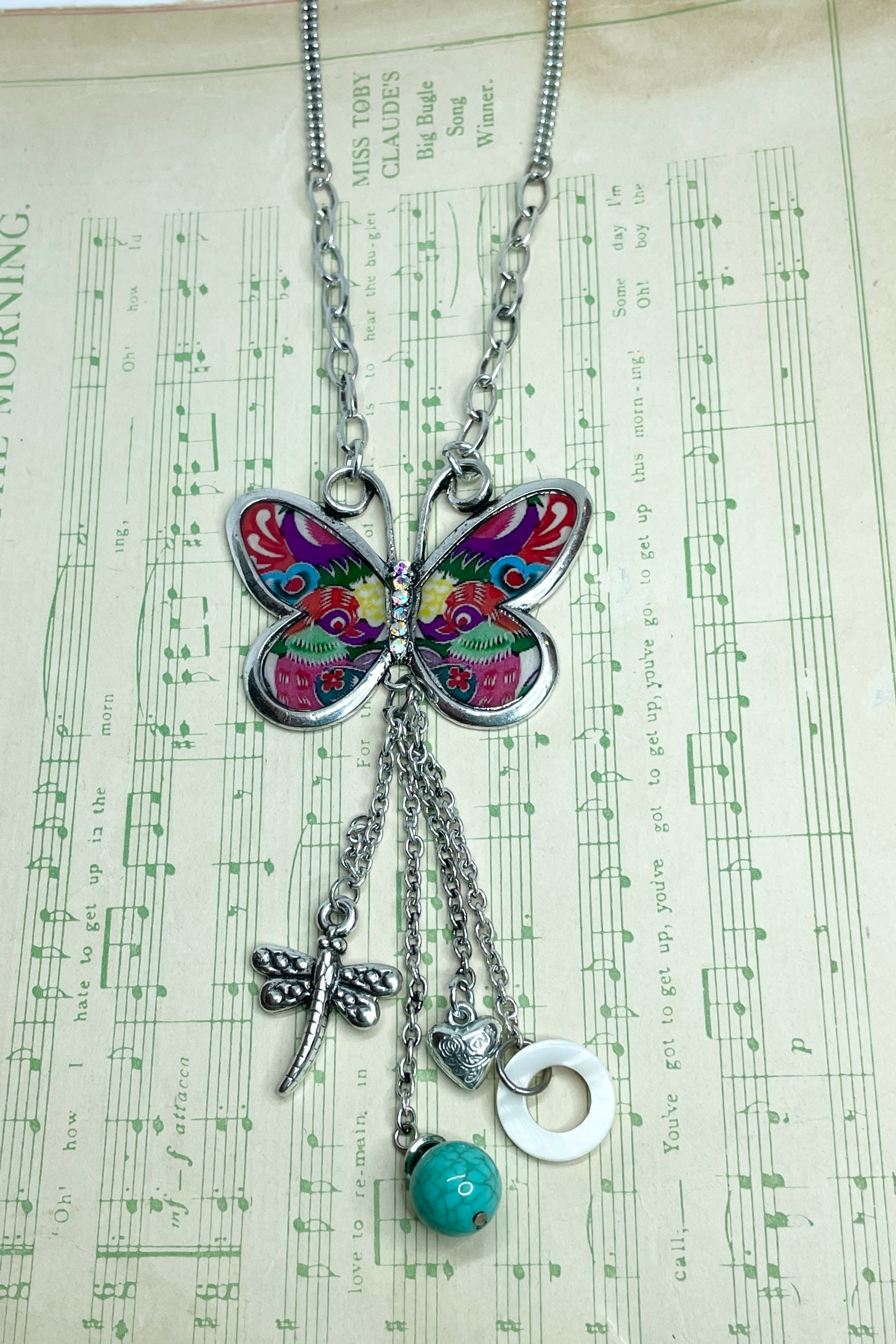 A really fun psychedelia necklace featuring a diamante studded butterfly.