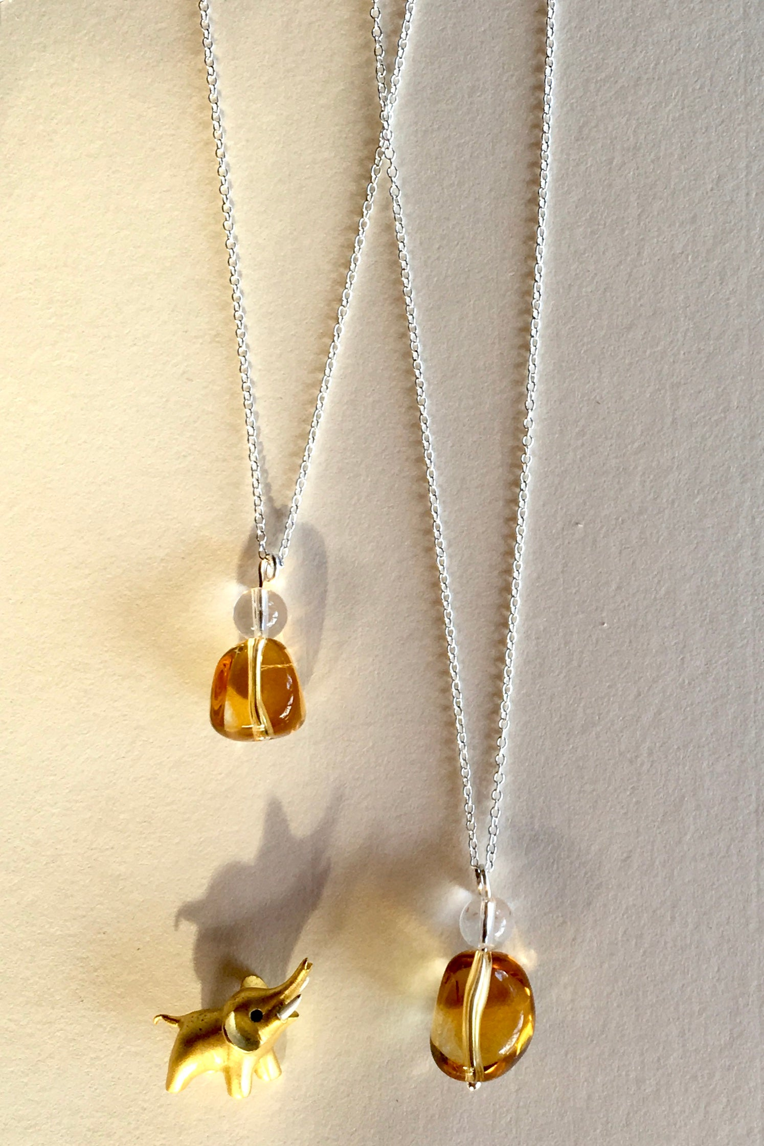 Pendant of Citrine with Rock Crystal has been cut 2.25cm to 2.5cm long total and tumble polished to reveal all the lovely golden tones hidden inside coming on silver chain.