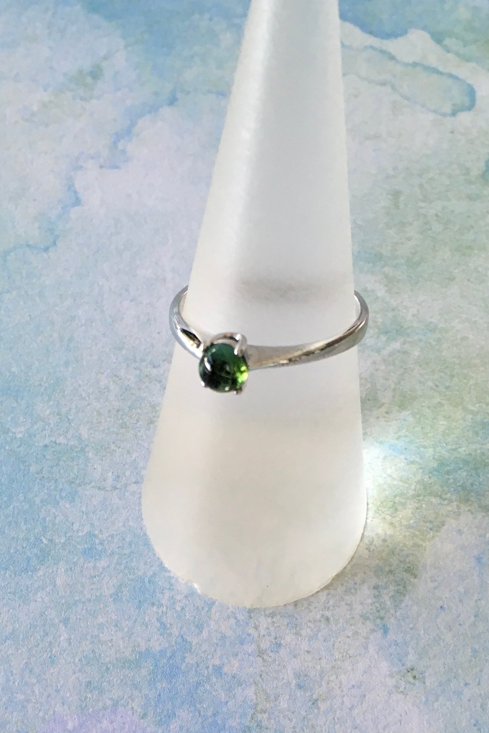 Tourmaline gemstone is set in a 925 silver ring,