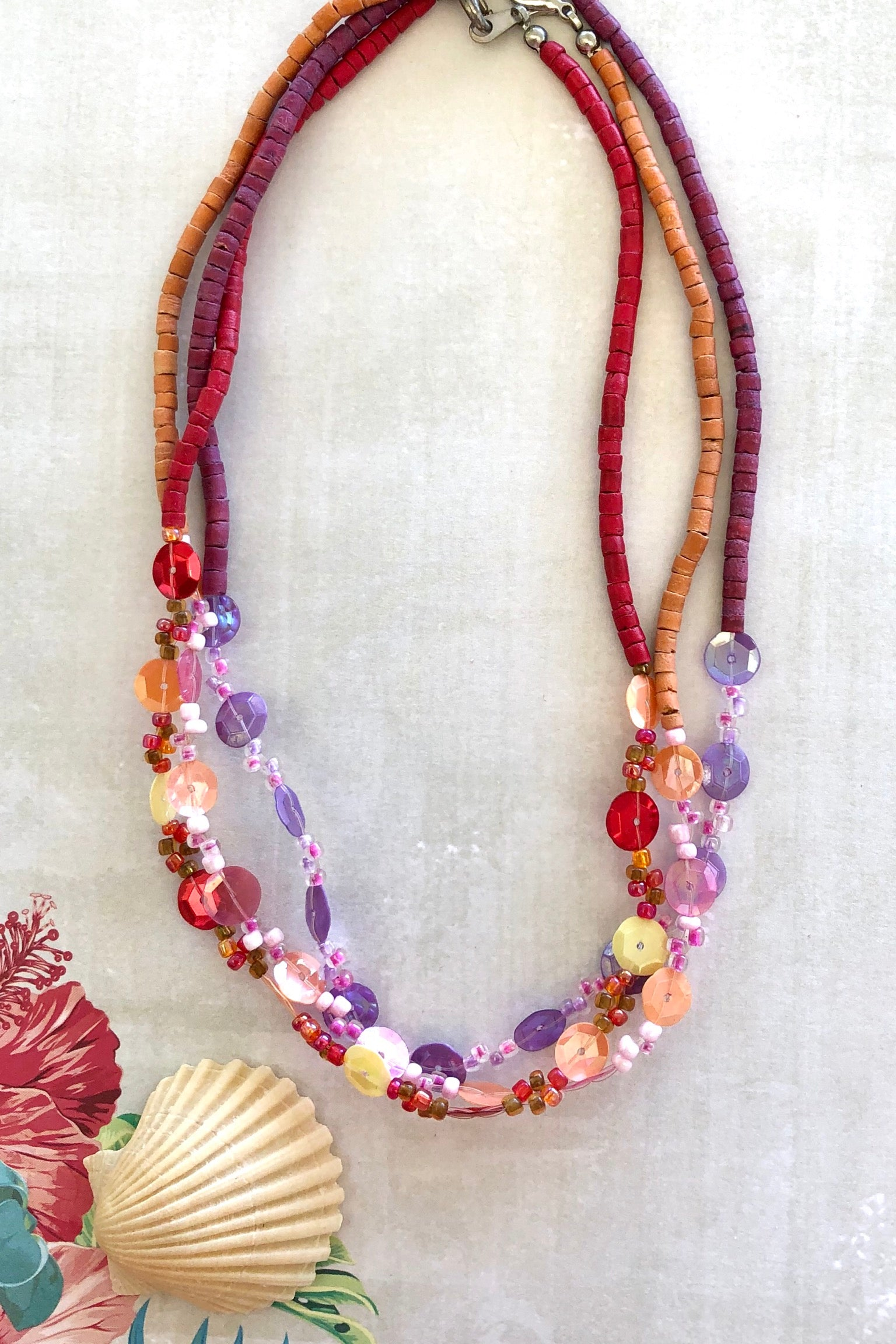 Three Necklace Trio Beach set is made from hand cut wood beads featuring beautiful colours, red, purple and orange.