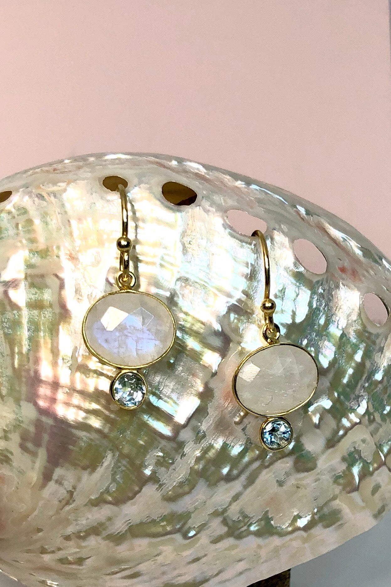 Oracle Earrings Luna Moon, drop style earrings features Moonstone and Blue topaz rim set and 9ct Gold vermeil surround and hook.