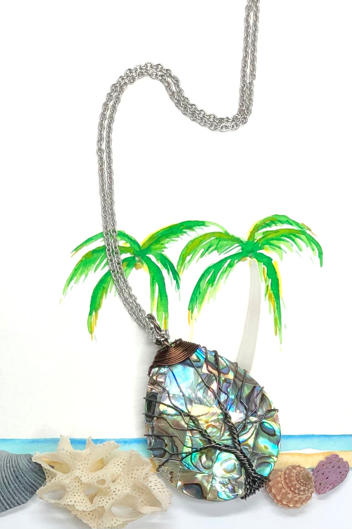 This pure and lovey Paua or Abalone shell pendant is polished to a high shine, it has a gorgeous Tree of life detail wire wrapped over the surface.
