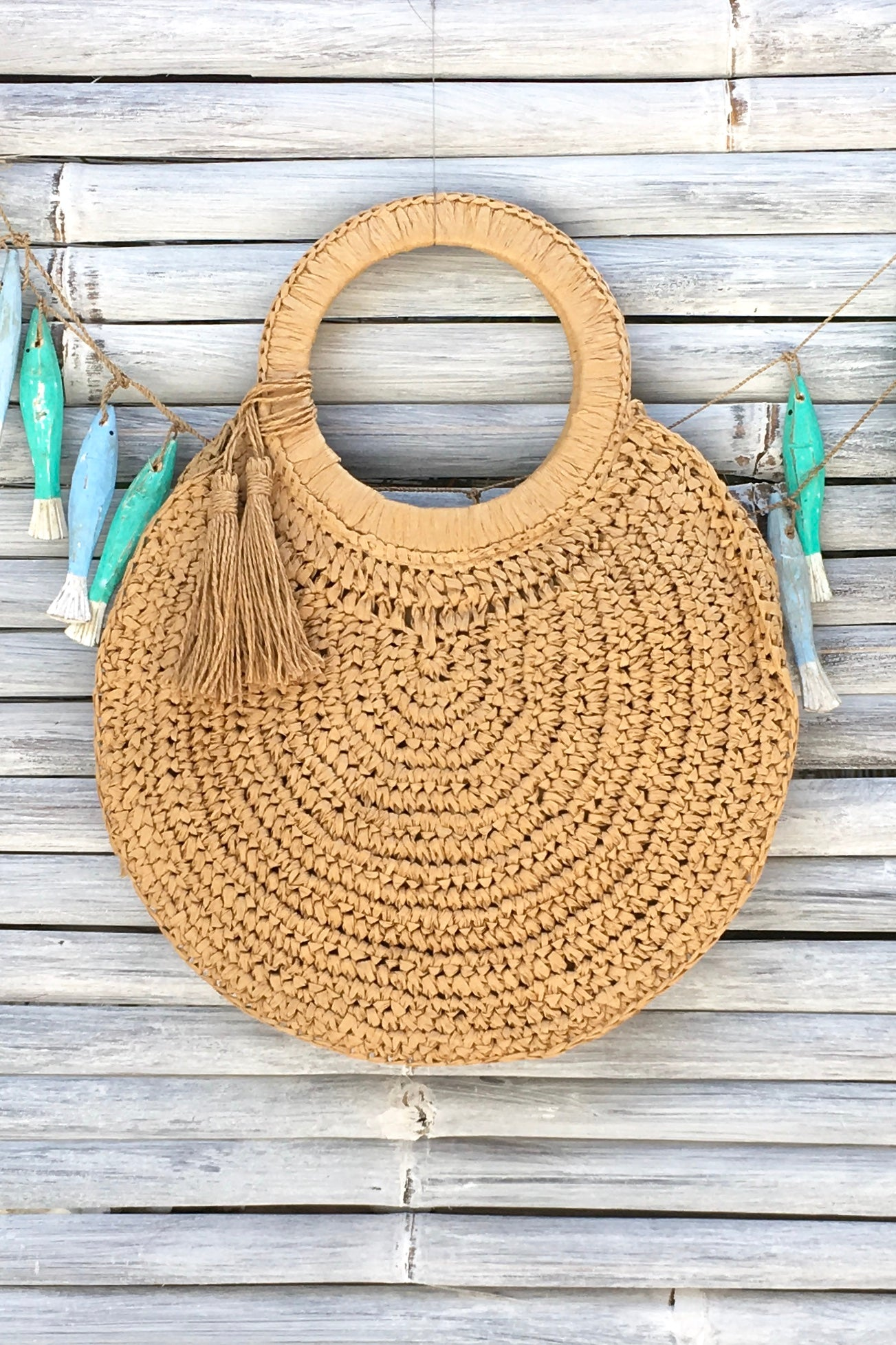 a stylish circular woven straw bag to fit your books