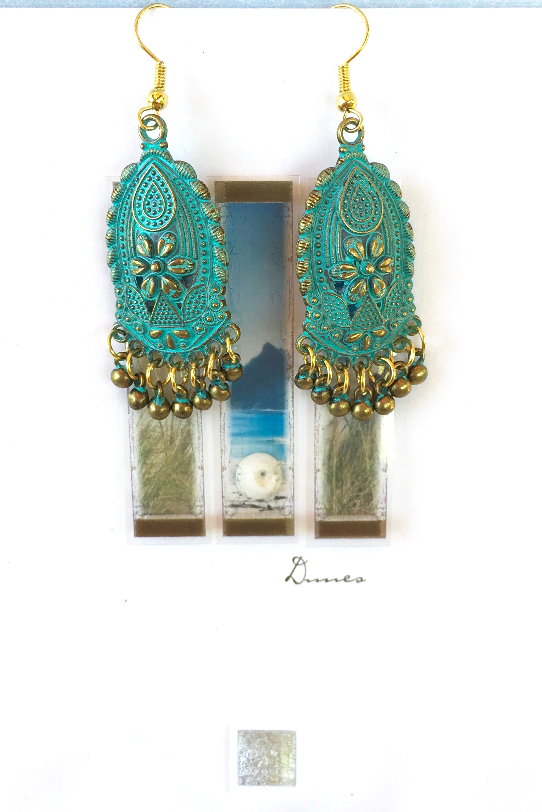 Women's Jewellery. Statement turquoise drop earrings. Ancient bohemian inspired accessory. Gold metal hook. Drop style turquoise flowers medallions with ancient bronze finish. Jingling beads. Perfect gift for ladies, everyday wear, night out. Designed in Brisbane Australia.