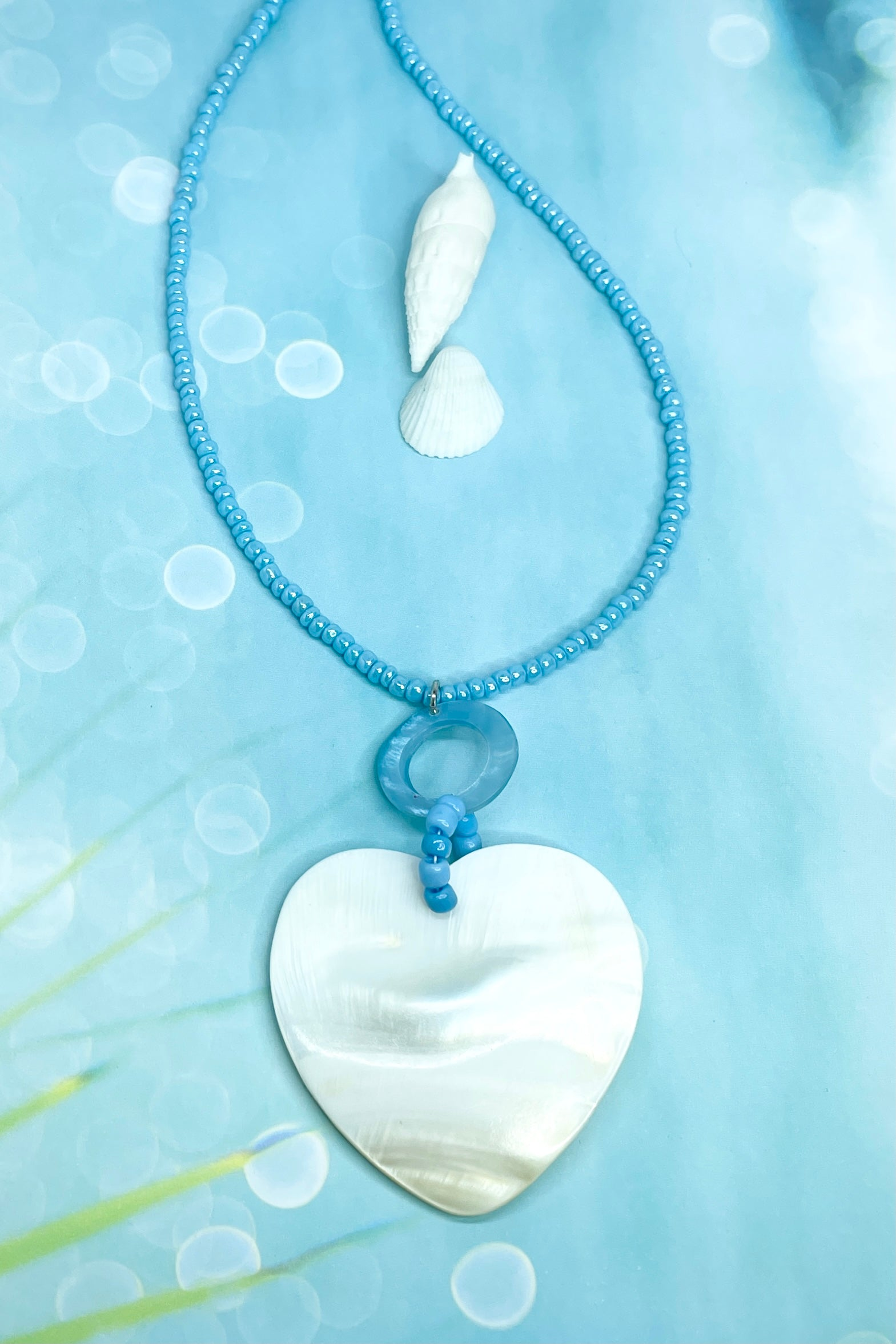 with a love heart hand carved from Mother of Pearl shell,
