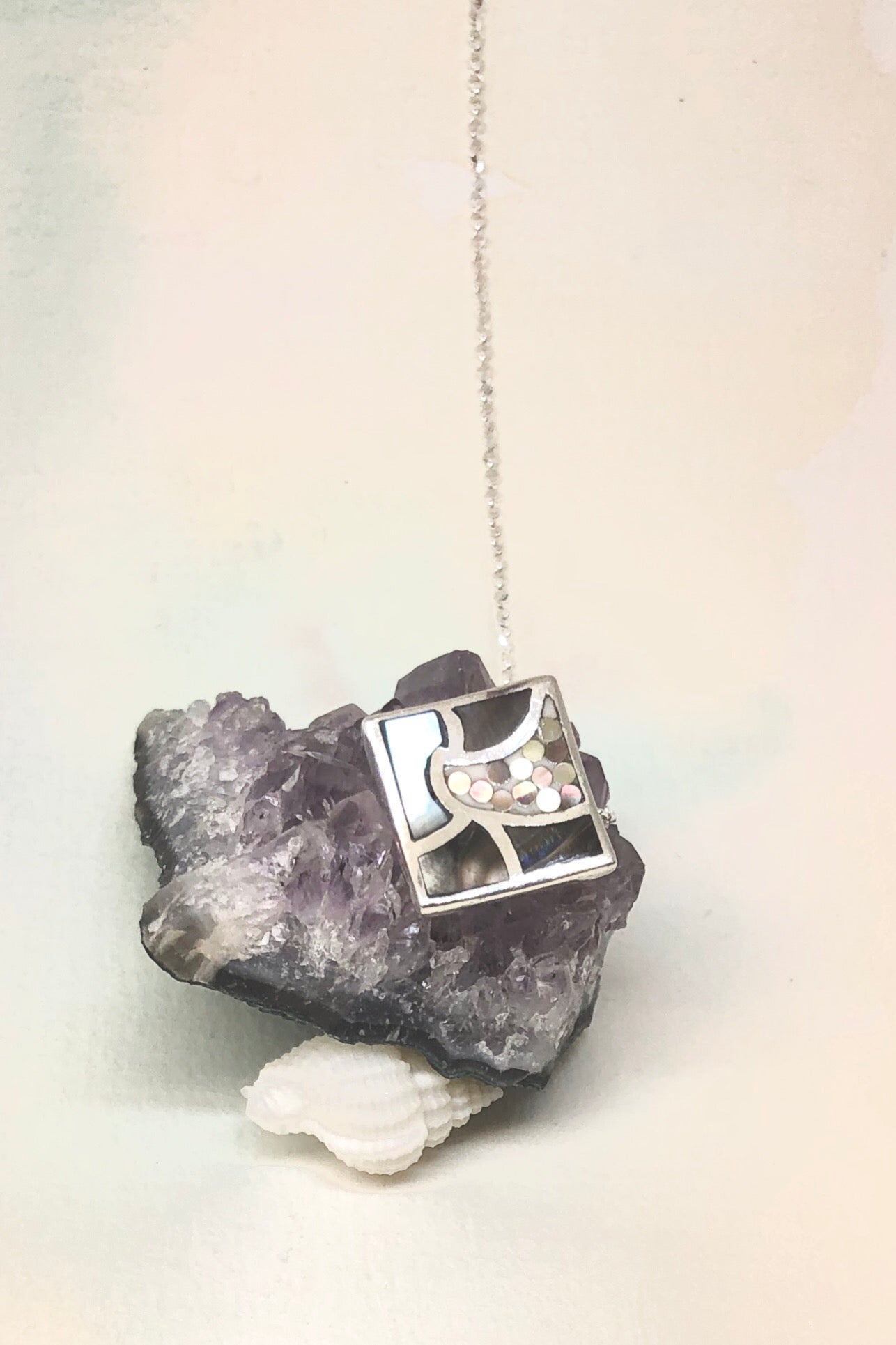 Echo Mosaic Inlaid Pendant has 1.5 cm long high grade natural Mother of Pearl shell and comes on 925 silver chain.
