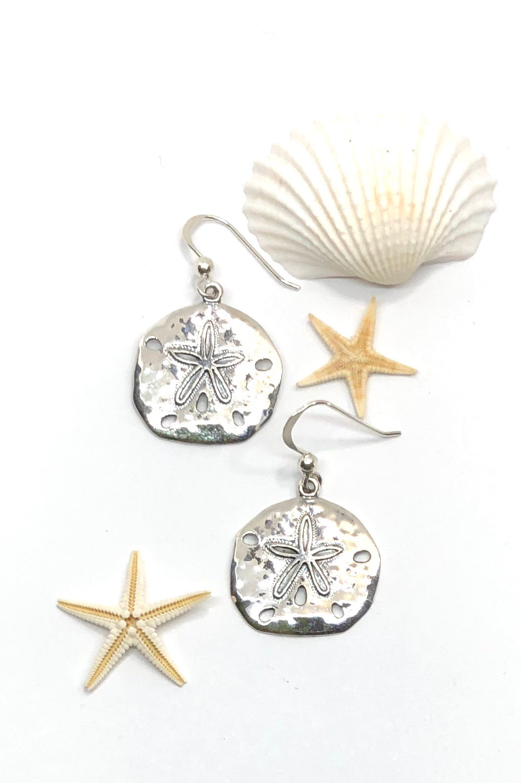 silver earrings in the shape of a tiny sea urchin are perfect for everyday wear