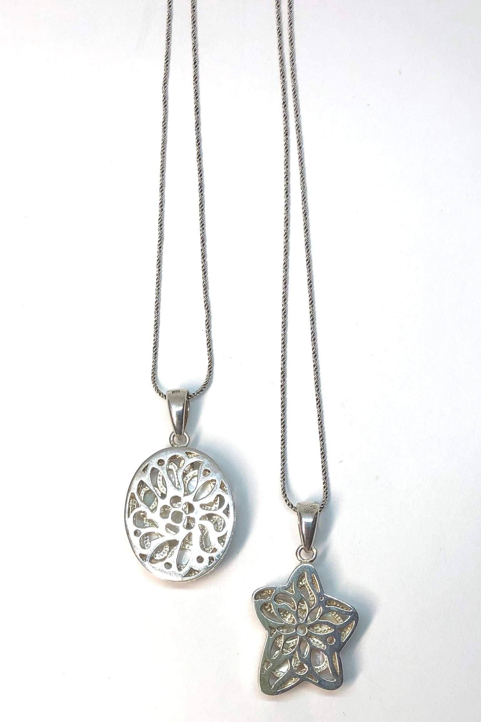 The Echo Mosaic Pearly Pendant Star is 925 silver, star shaped, inlaid with Mother of Pearl in the softest colours and Comes on a 51 cm silver snake chain with antique finish.