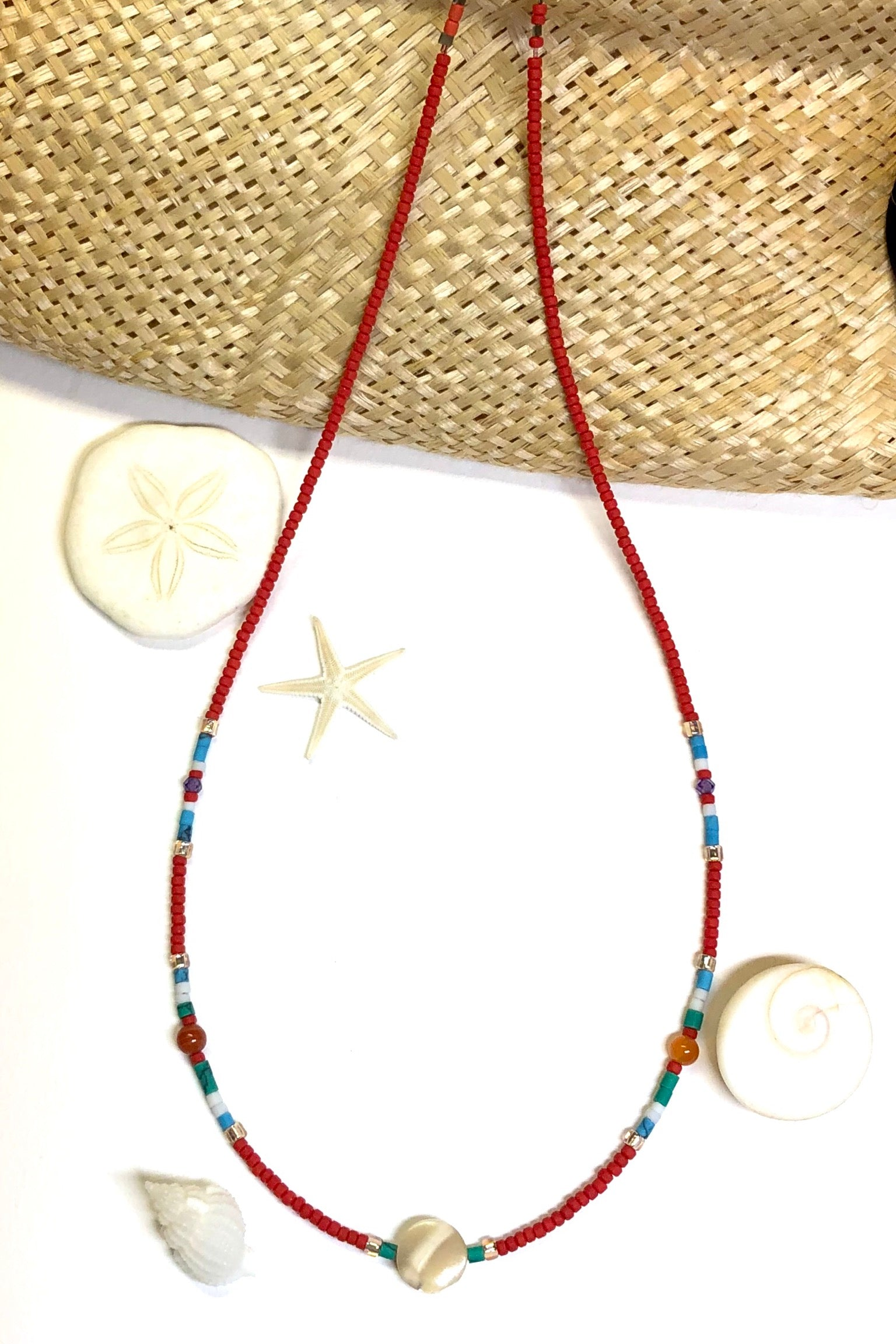 Necklace Cay Island Green is exclusive and handmade featuring 45cm in length and tiny Afghan seed beads, Mother of Pearl, glass and carnelian stone.