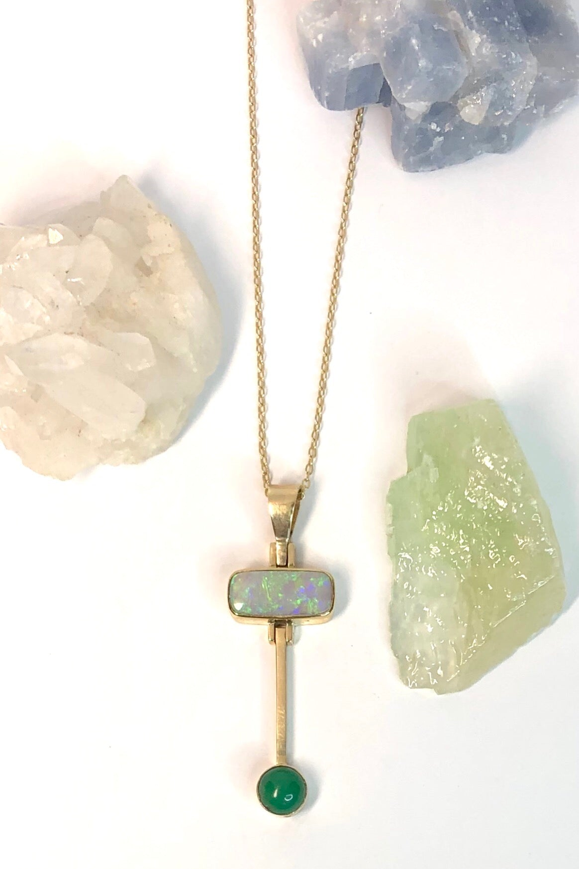 unusal Vintage pendant has a stunning solid Australian Opal with hanging bar which has a deep green Queensland Chrysoprase cabochon detail.