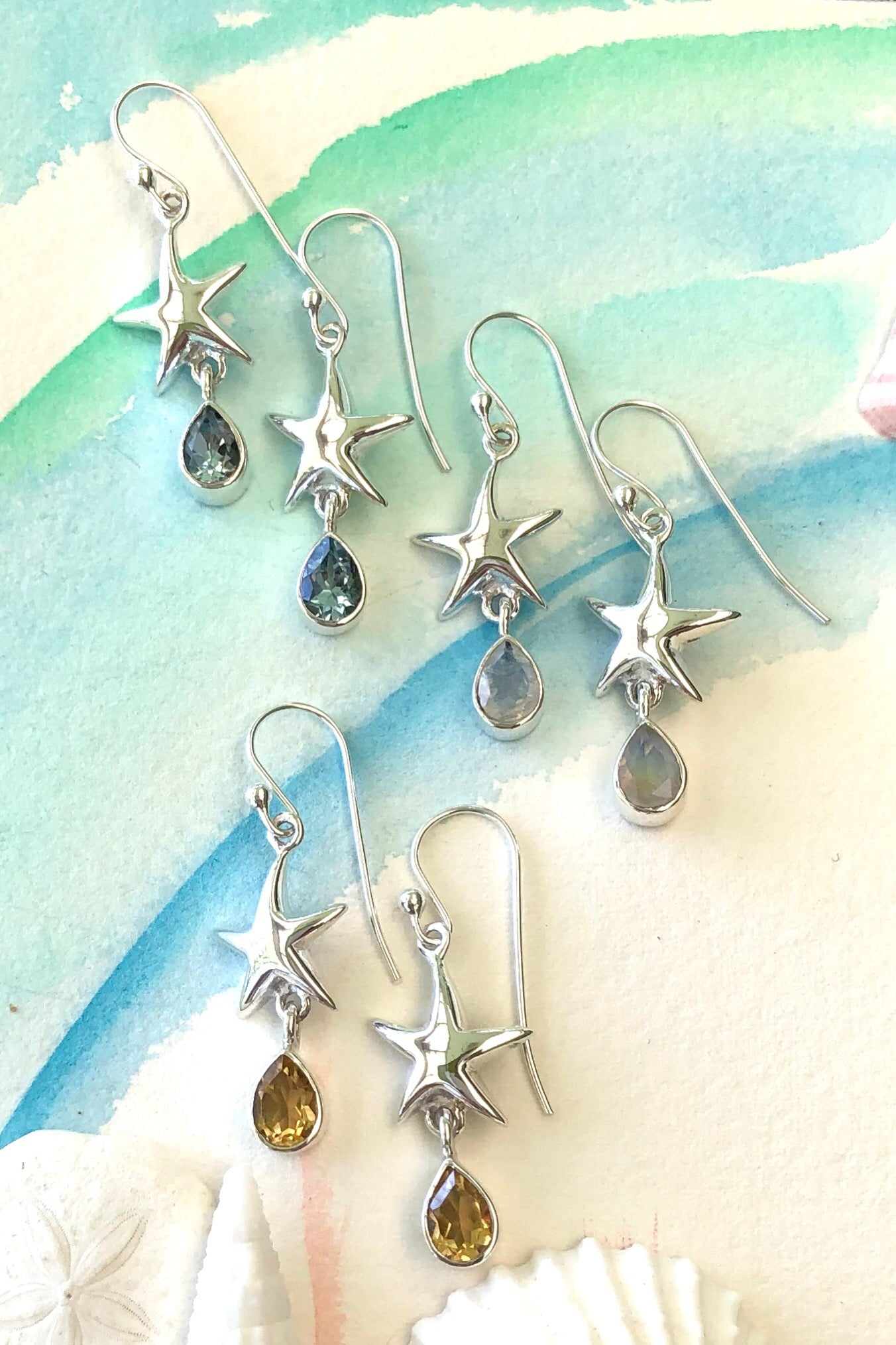 Oracle Silver Seas Earrings Starfish Circle are a halo of 925 silver quoting 'Sea, Sun & Sand