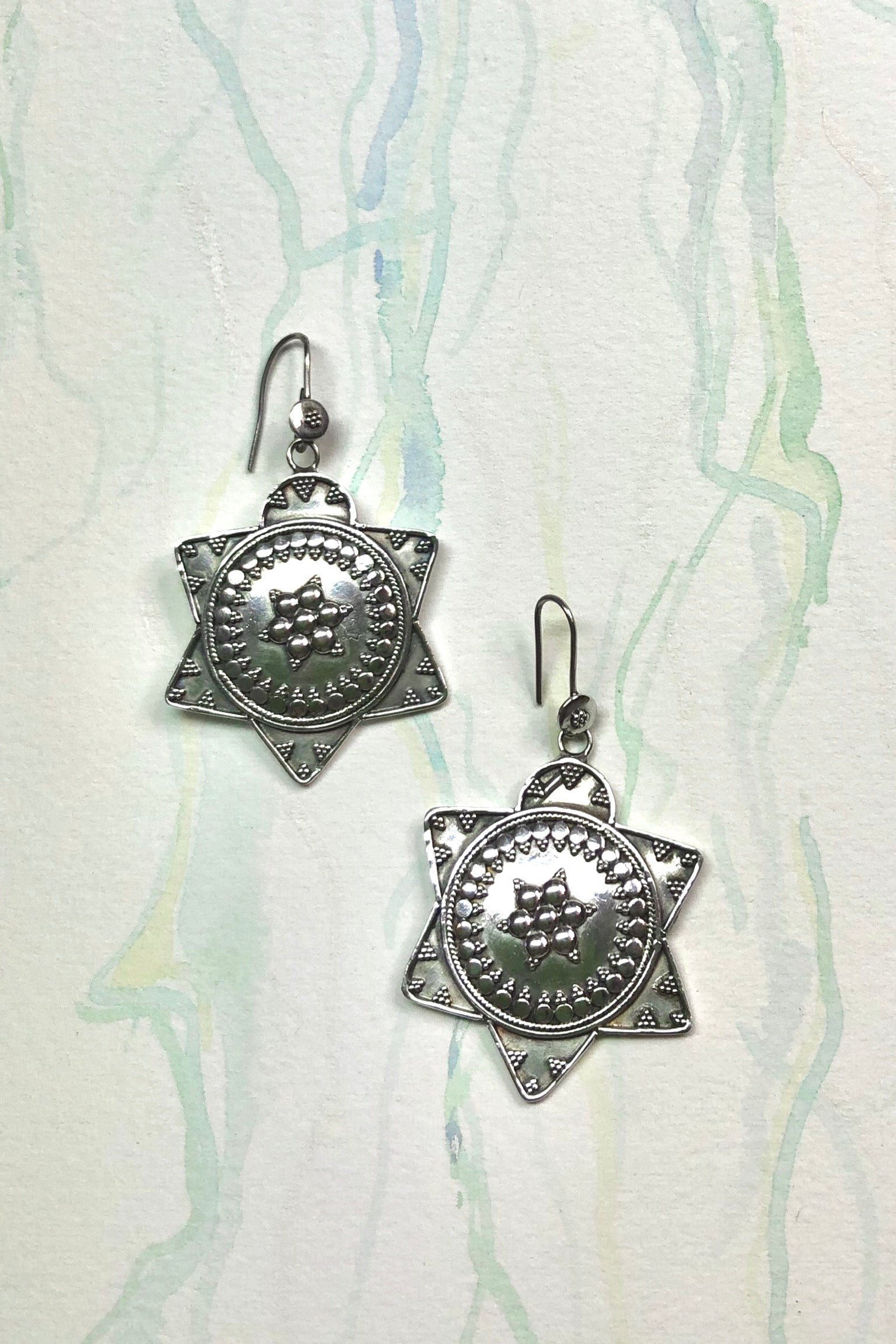 The Earrings Echo Star Power are boho silver jewellery and handmade silver star earrings.