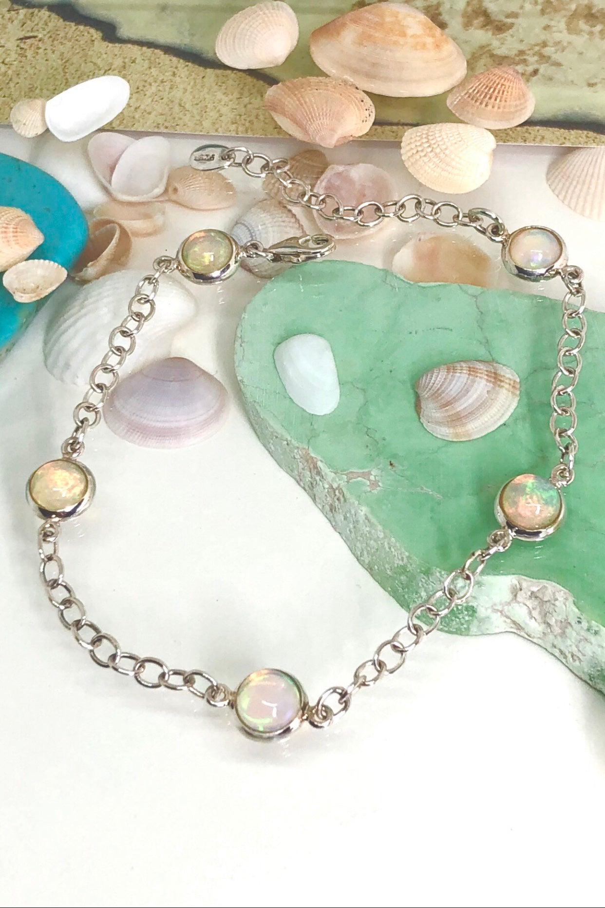 Oracle Bracelet Opal Gems is a real little beauty, with five colourful little opal gemstones each rim set in silver and joined with a silver chain