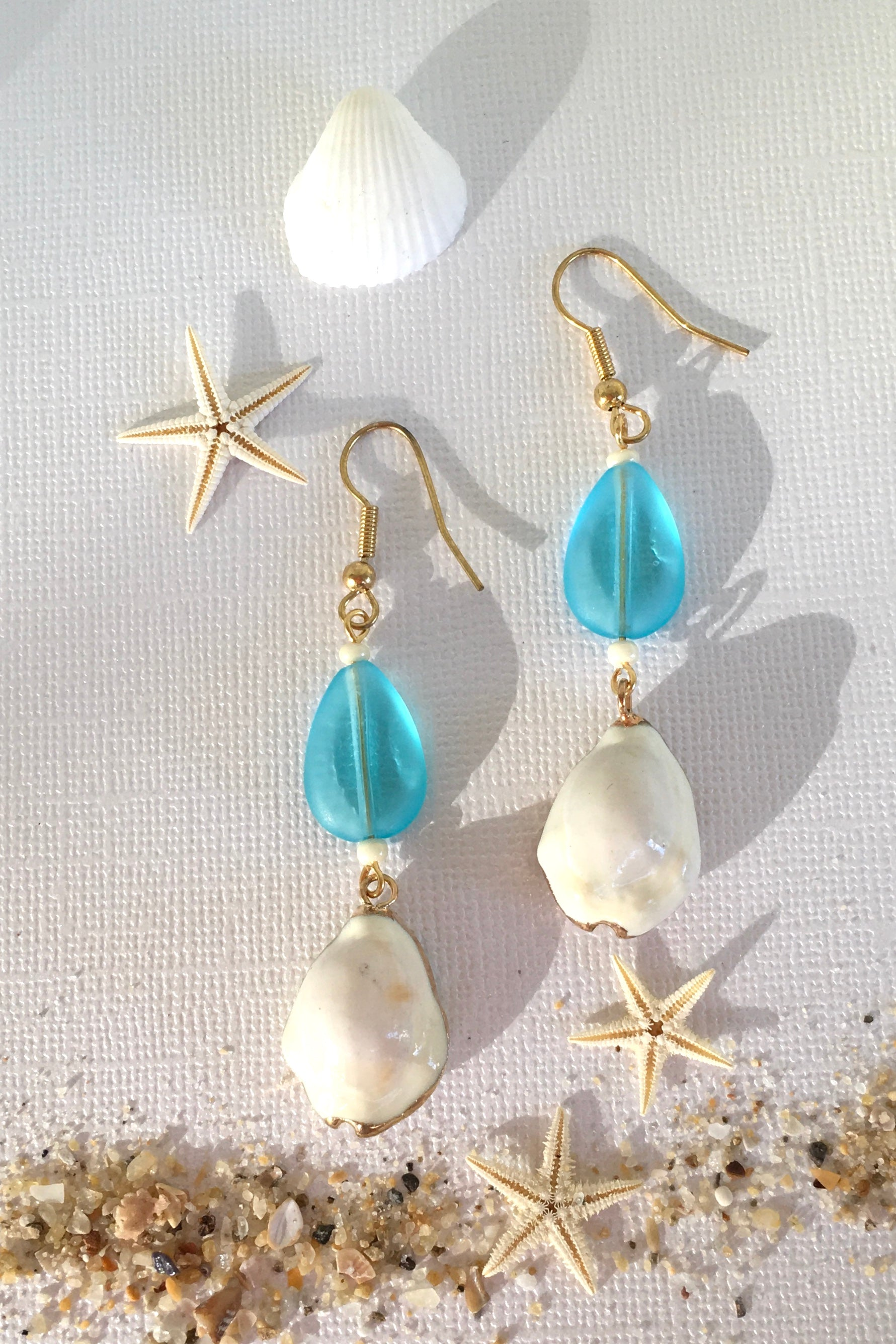 Earrings High Tide Cowrie Shell with Clear Aqua Glass Bead