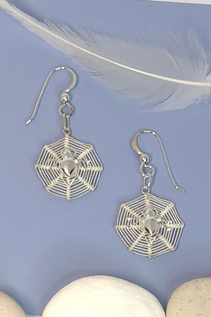 Earrings Sala Spiders Web in 925 Silver are drop style earrings featuring a tiny silver spider on a web.