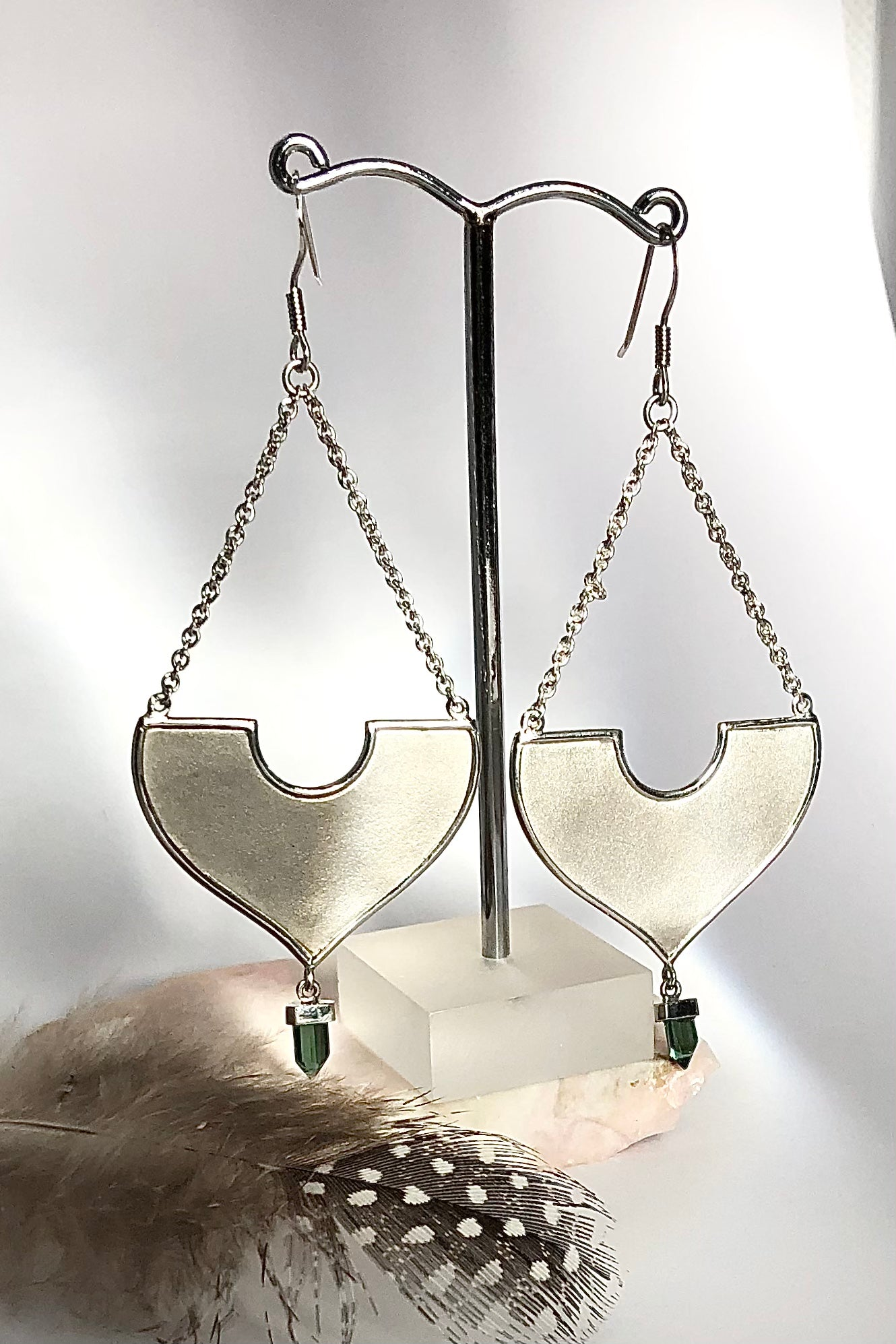 A stunning African Style 925 silver Earrings with a Tourmaline Shard which hangs perfectly through a silver circle.