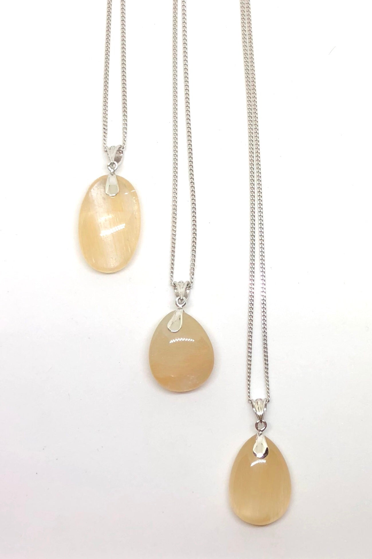 Pendant of Golden Rutilated Quartz on a Silver Chain 1