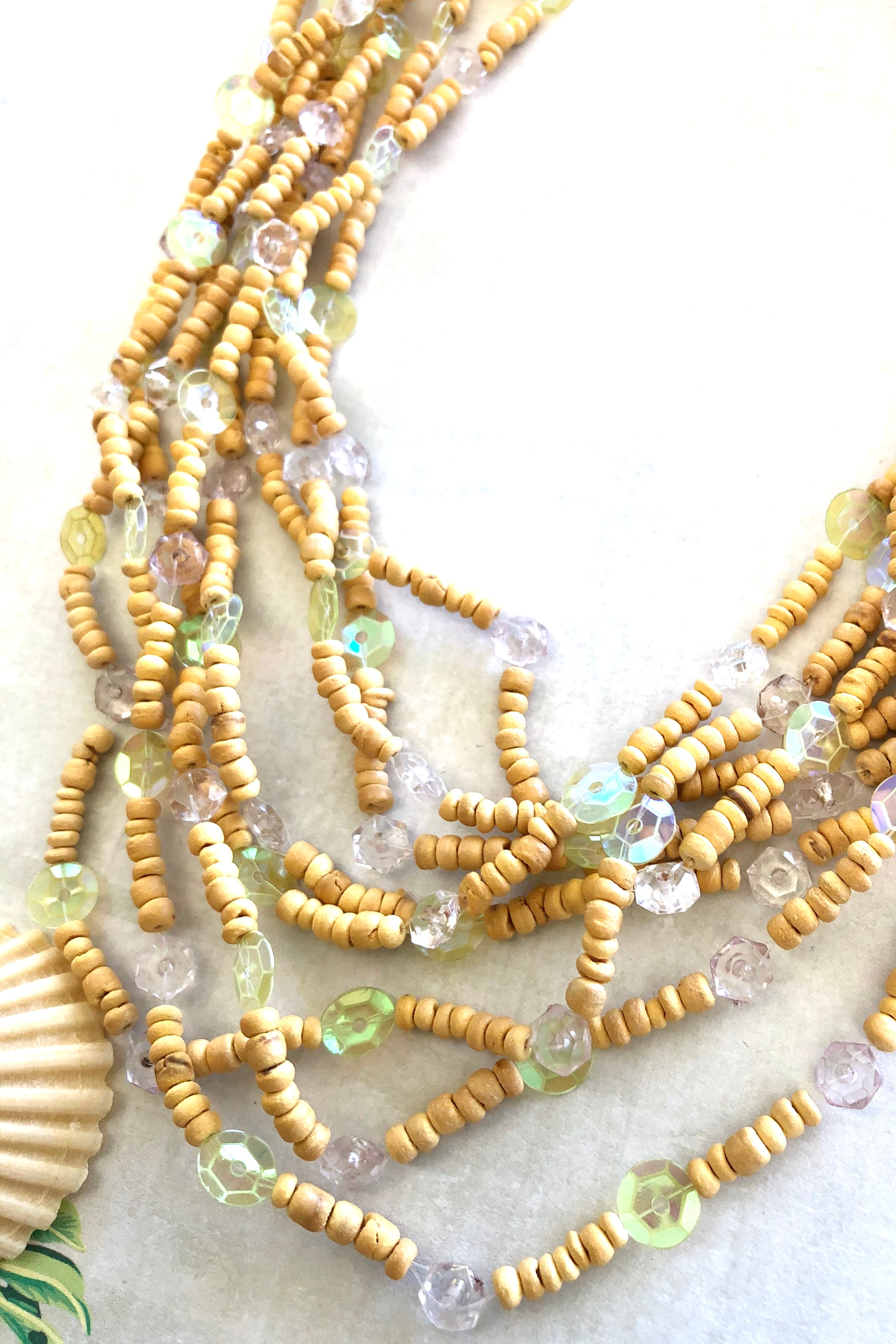 This Lovely Necklace  Blu Luminescence Beach is made from small hand cut wooden beads in pale creamy yellow.