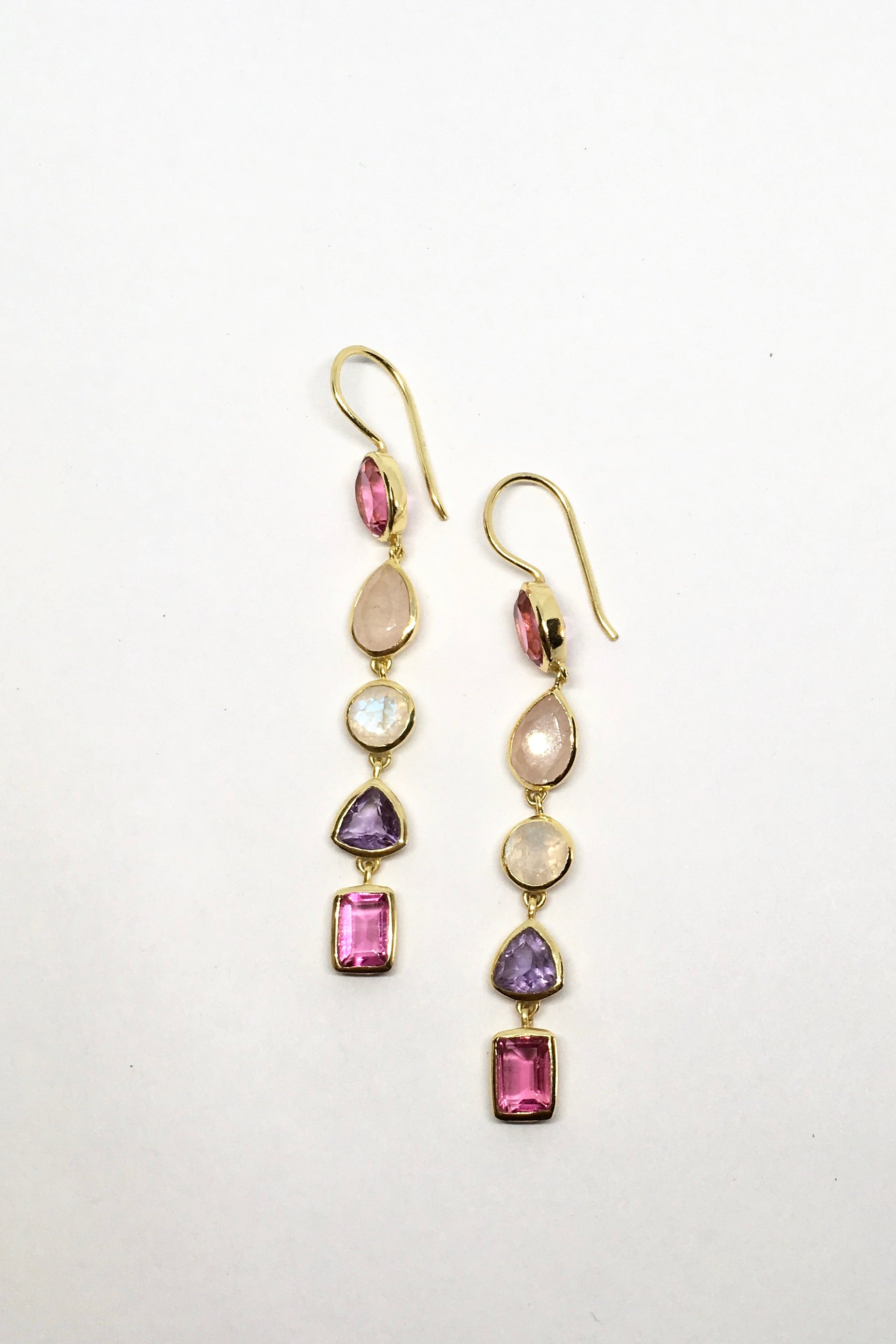 Oracle Earrings Golden Rainbow Pinks are ultra feminine drop style gold vermeil earrings. Boasting different shades of pink quartz