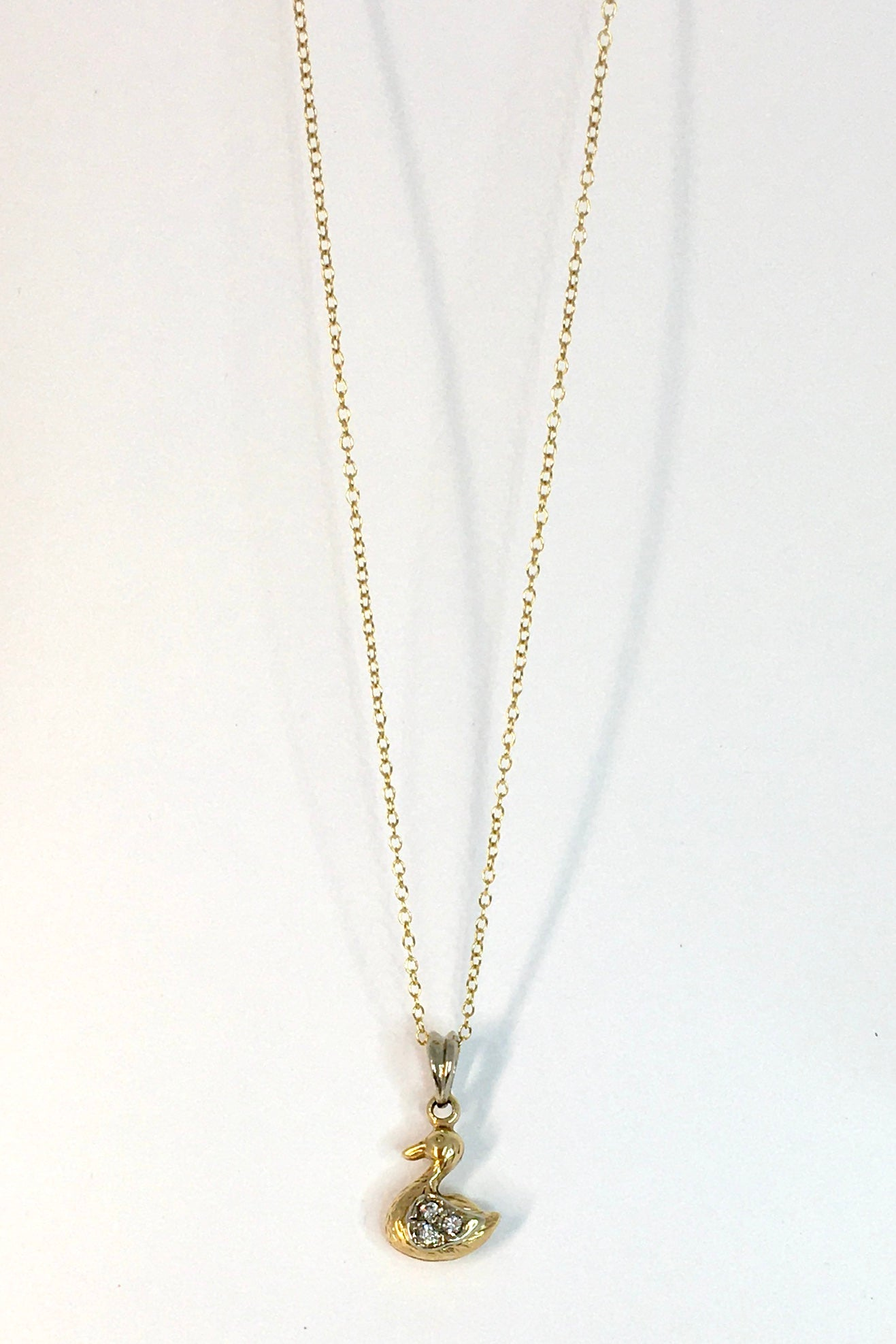 The Vintage Pendant Little Gold Duck is a 9ct gold duck pendant featuring silver pendant bail and 9ct gold chain.