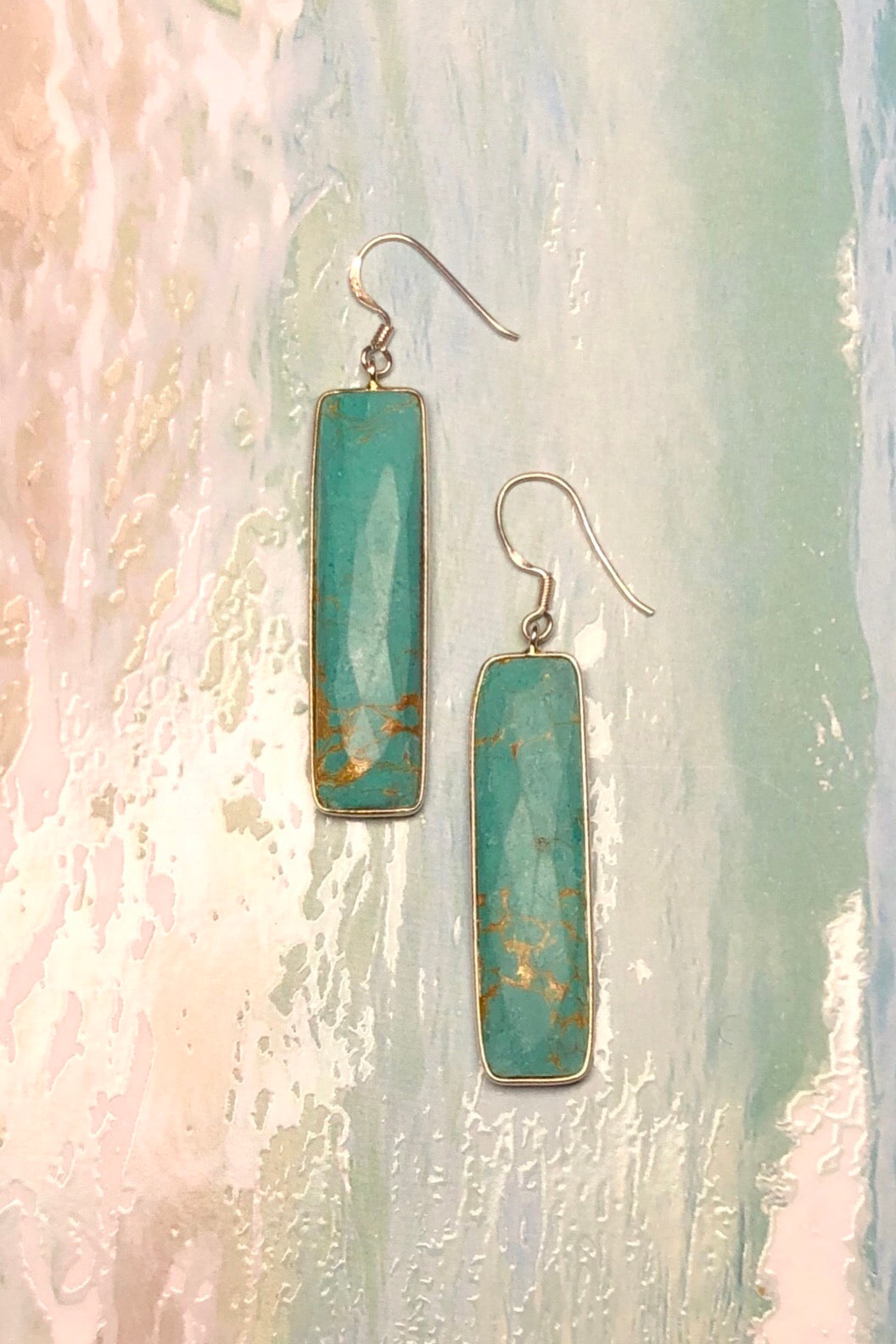 The Serendipity Aqua Yan Earrings are handmade drop style earrings featuring 6cm long total, Silver hook, Composite Turquoise colour.