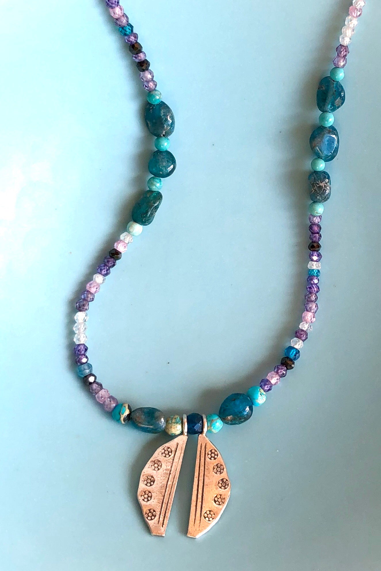 The Necklace Cay Friendship Amulet is exclusive handmade necklace featuring natural blue apatite beads, tiny faceted semi precious stones, turquoise howlite and Turkish glass beads.