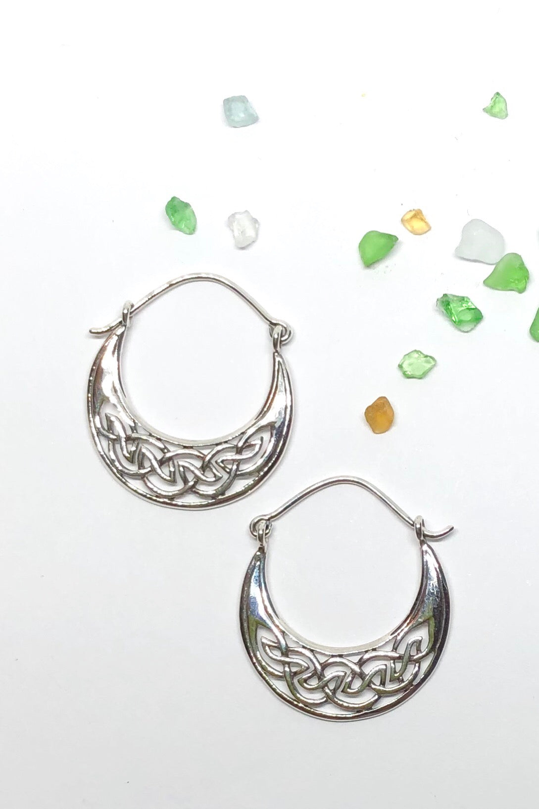 The Earrings Cay Celtic Silver Hoops are 925 solid silver, exotic hoop design in silver, 3 cm in length, 2.6 cm wide.