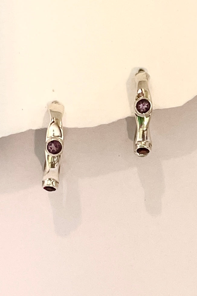 A chic pair of gem set hoop earrings.