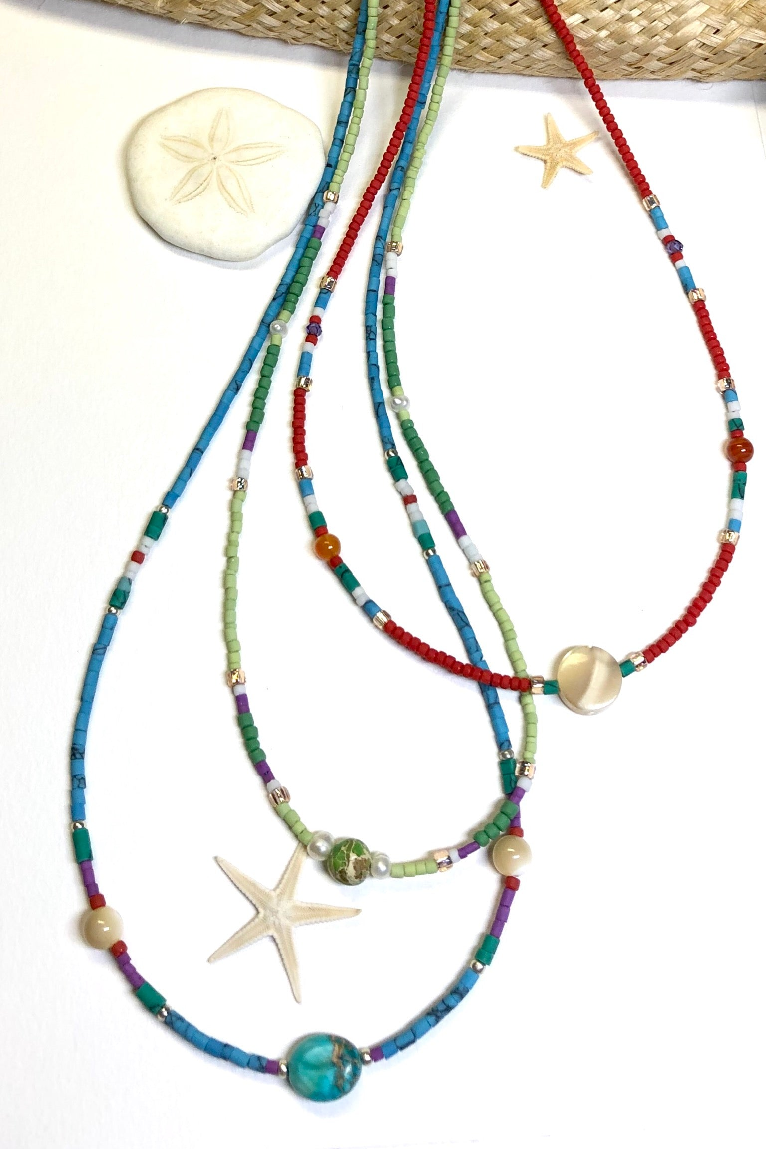 Necklace Cay Island Green is exclusive and handmade featuring 45cm in length and tiny Afghan seed beads, Mother of Pearl, glass and turquoise howlite stone.