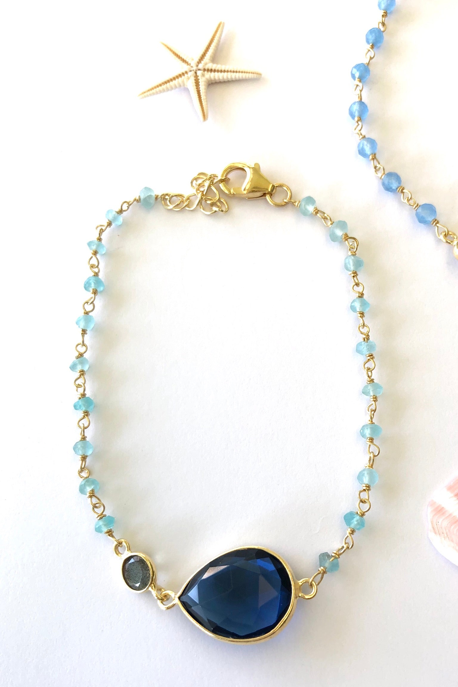a gold vermeil chain with glistening beads