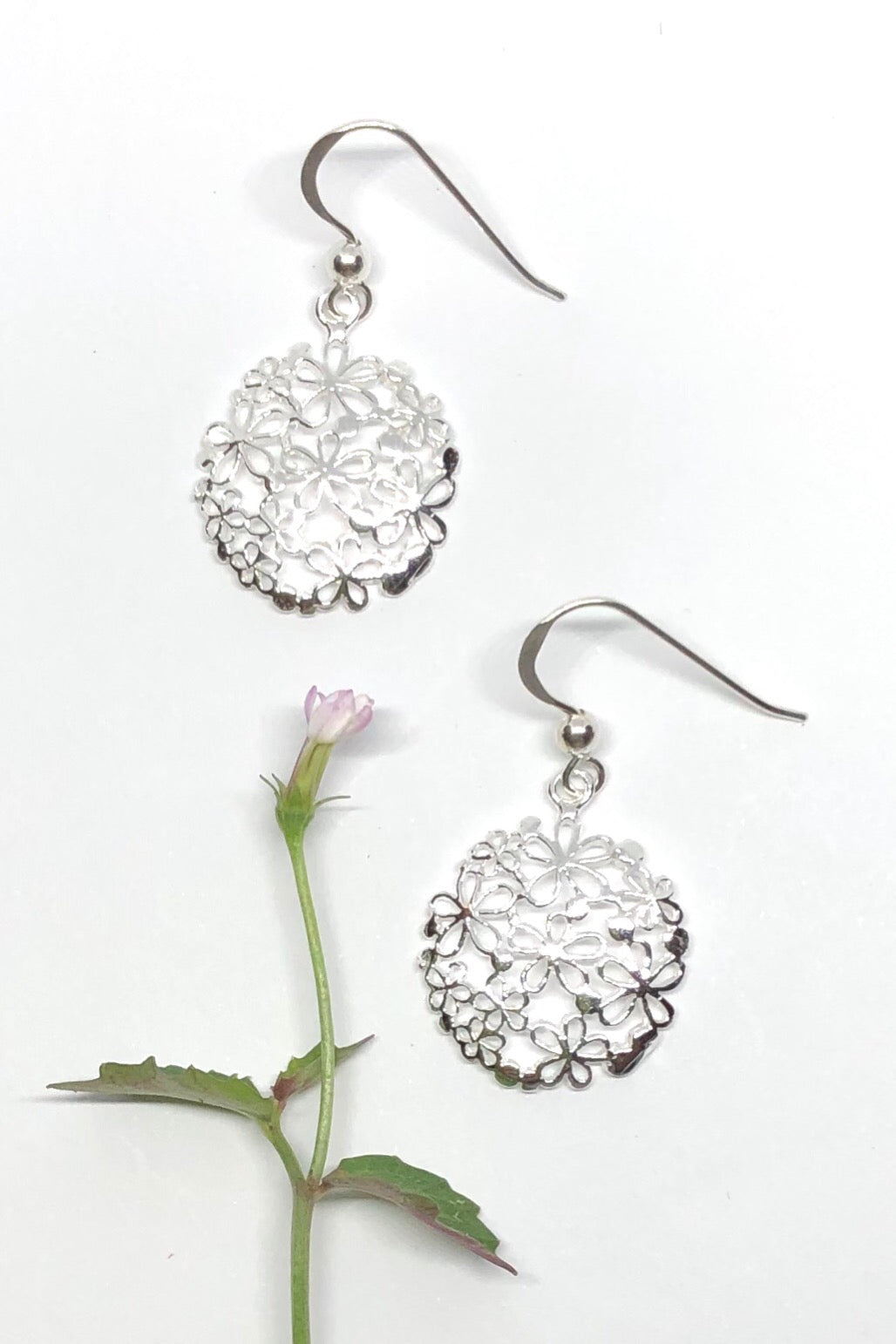 These pretty silver earrings will add some woodland magic to your jewellery collection.