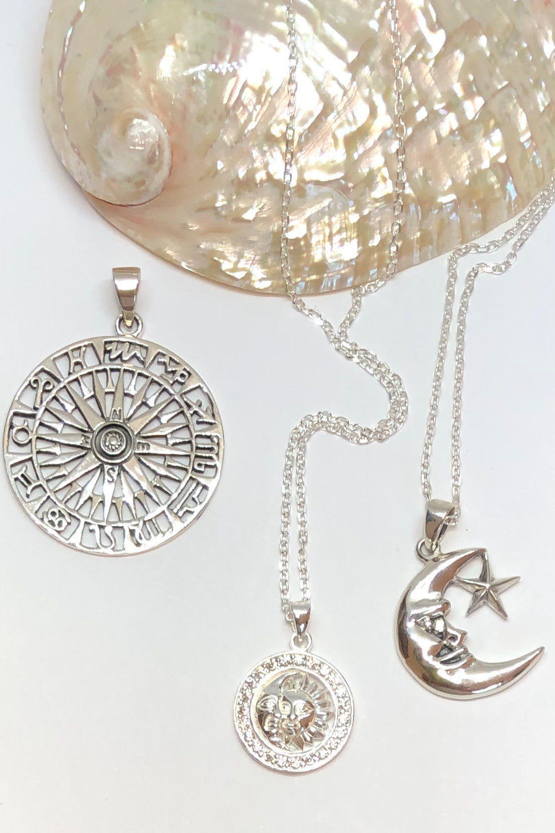 The Oracle Pendant Sun and Moon with Crystal is a delicate 925 solid silver pendant featuring 2cm in length, Silver faced crescent moon and sun with crystal and coming on a 925 silver chain.