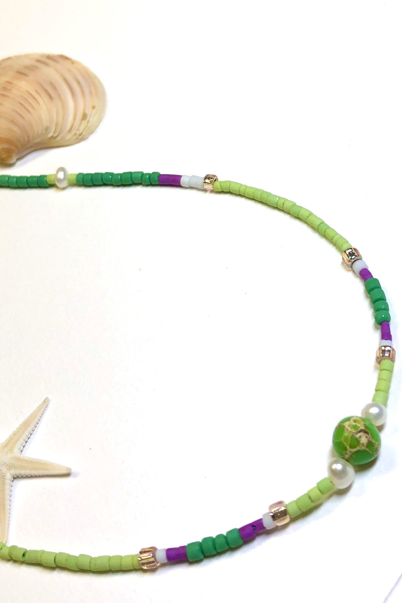 Necklace Cay Island Green is exclusive and handmade featuring 45cm in length and tiny Afghan seed beads, pearls, glass and natural stone.