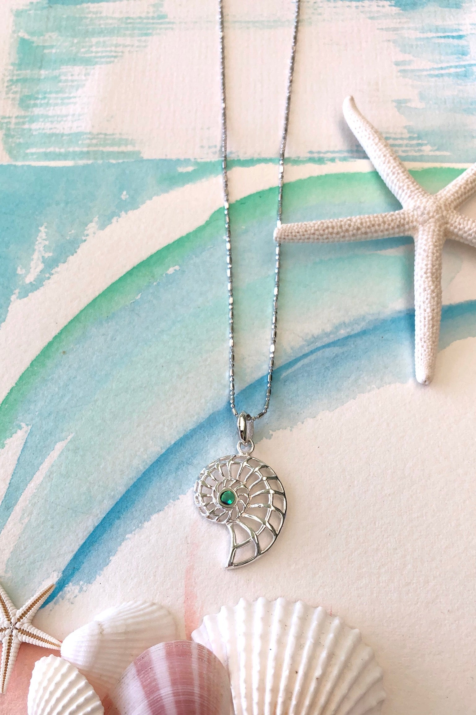 A beautiful nautical necklace with a Paua shell centre, bringing lovely warmth and gentle vibrations