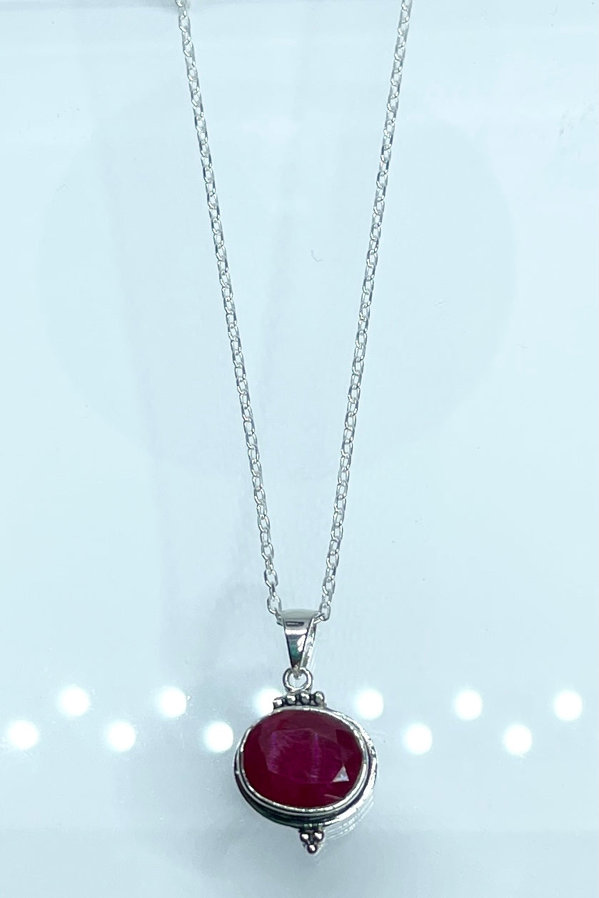 Oval ruby set in silver on a silver chain