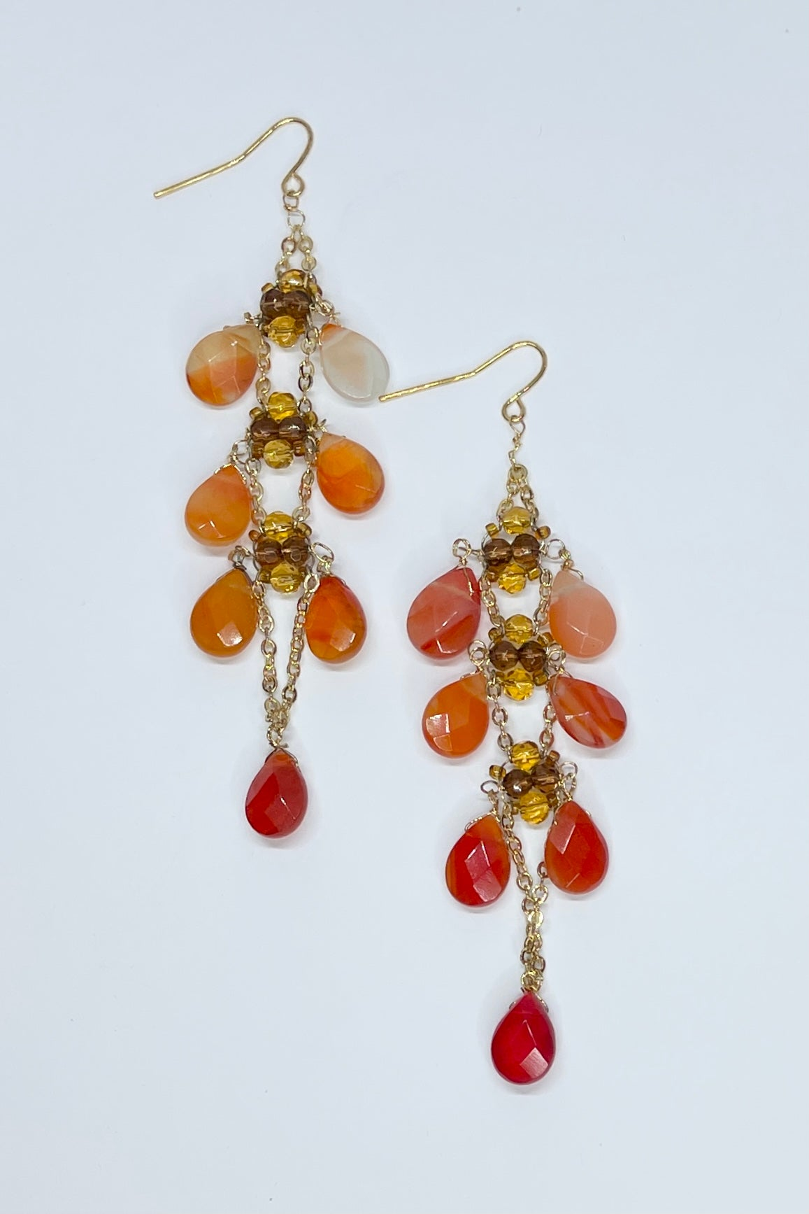Chandelier earrings with amber coloured glass droplets