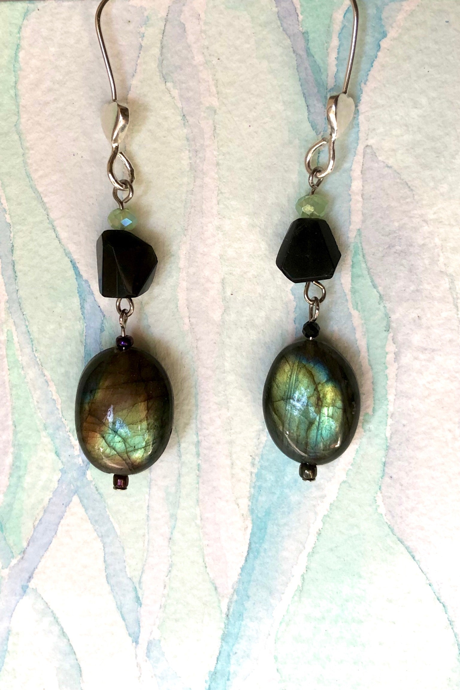 The Serendipity Earrings Labradorite Eve are handmade in Noosa featuring Natural black onyx bead, Oval Labradorite bead, Green Quartz bead and hook is 925 Silver.