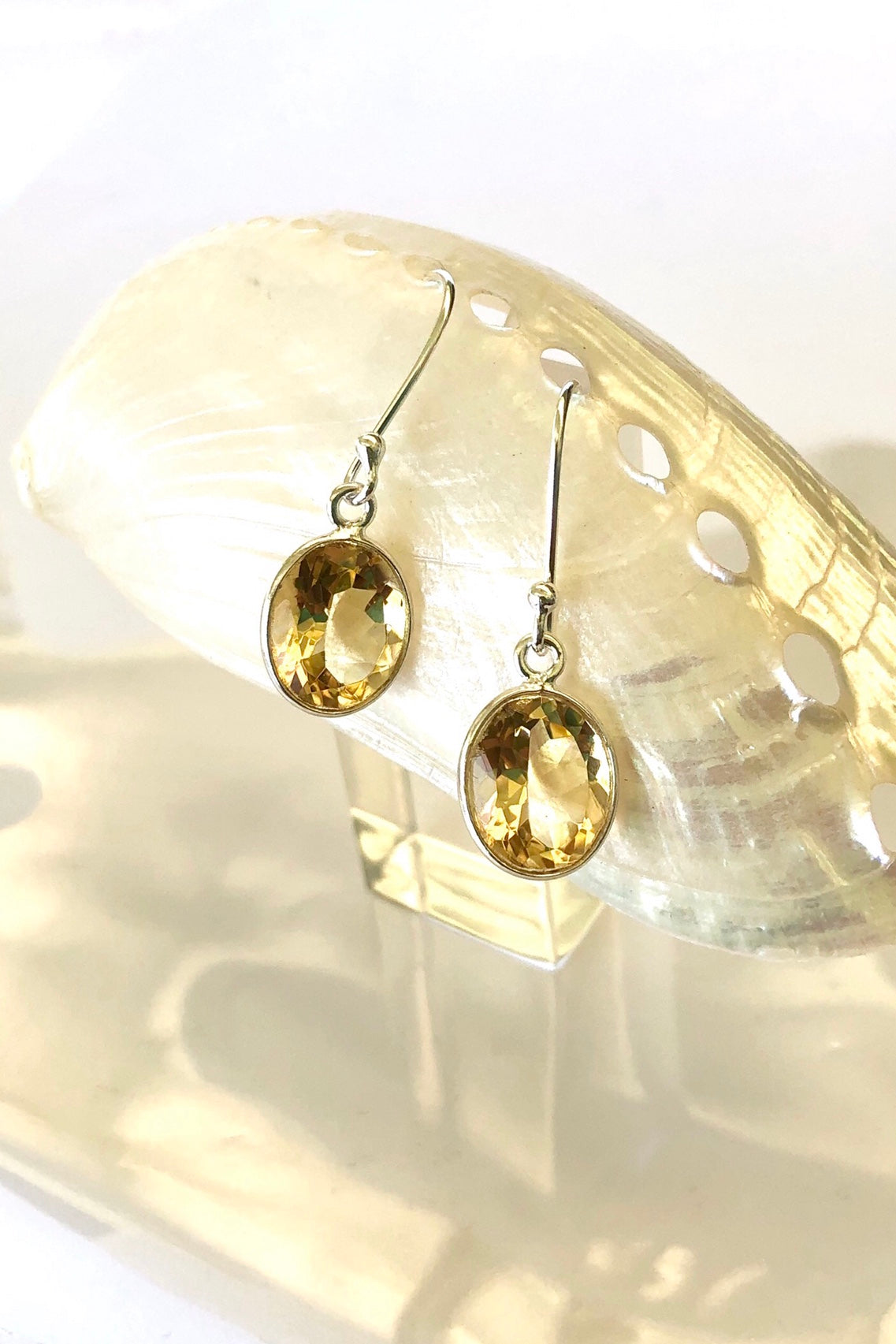 dainty Citrine gemstone sparkles in a silver earring
