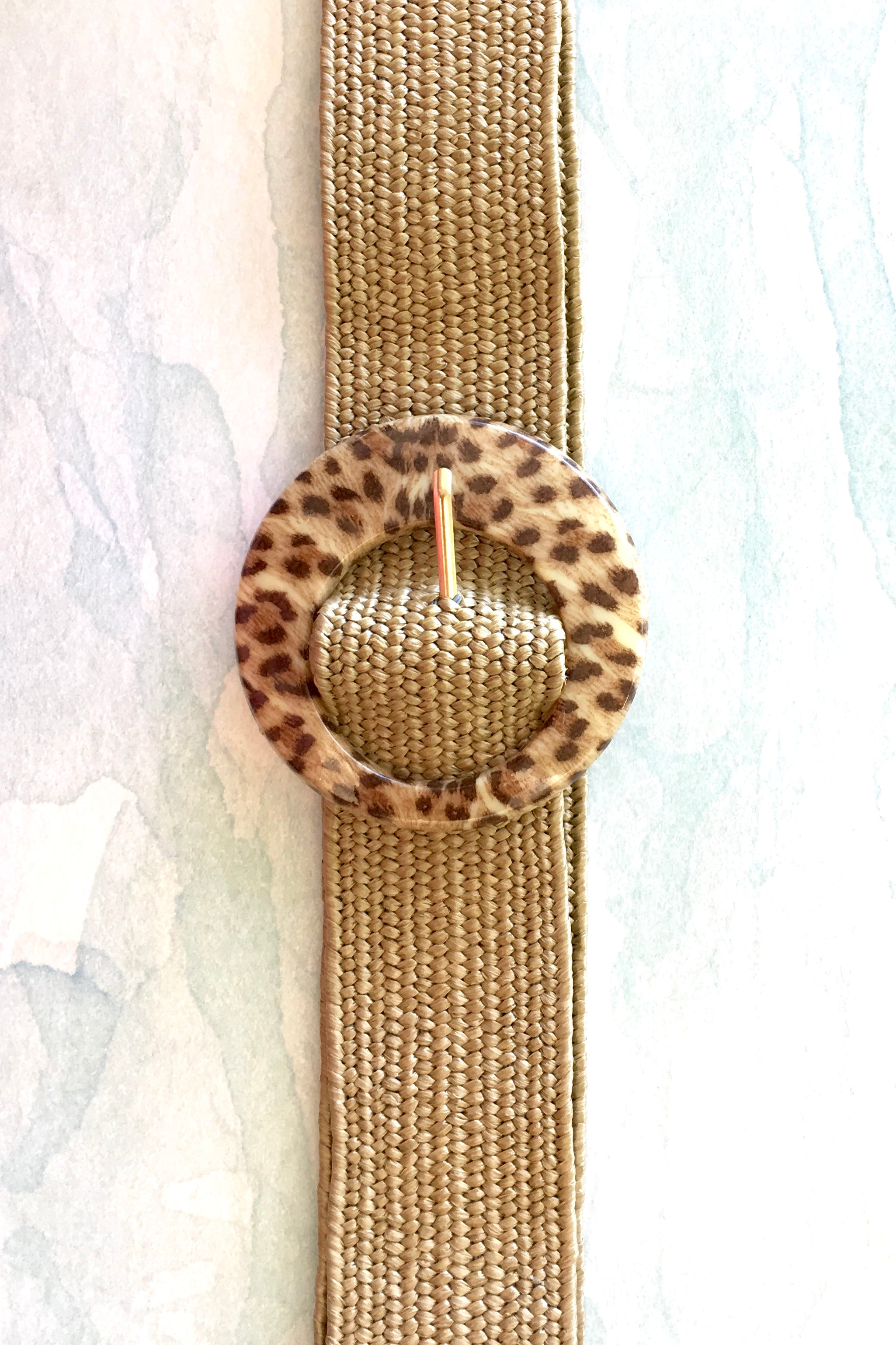 A gorgeous natural stretch belt with an added funky extra large leopard belt buckle
