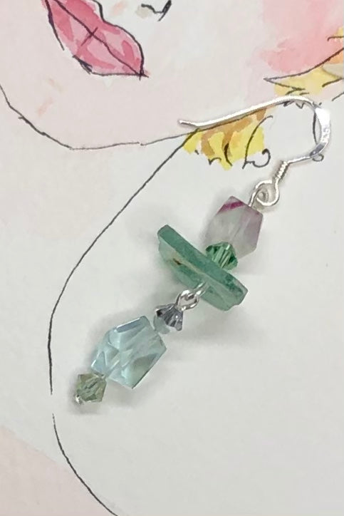 Hand cut antique glass set off with pale aqua Fluorite and swarovski crystal beads.