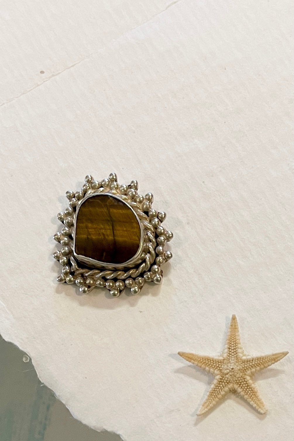 Vintage silver stud earring, made in India of silver with a teardrop shape in Tigers Eye,