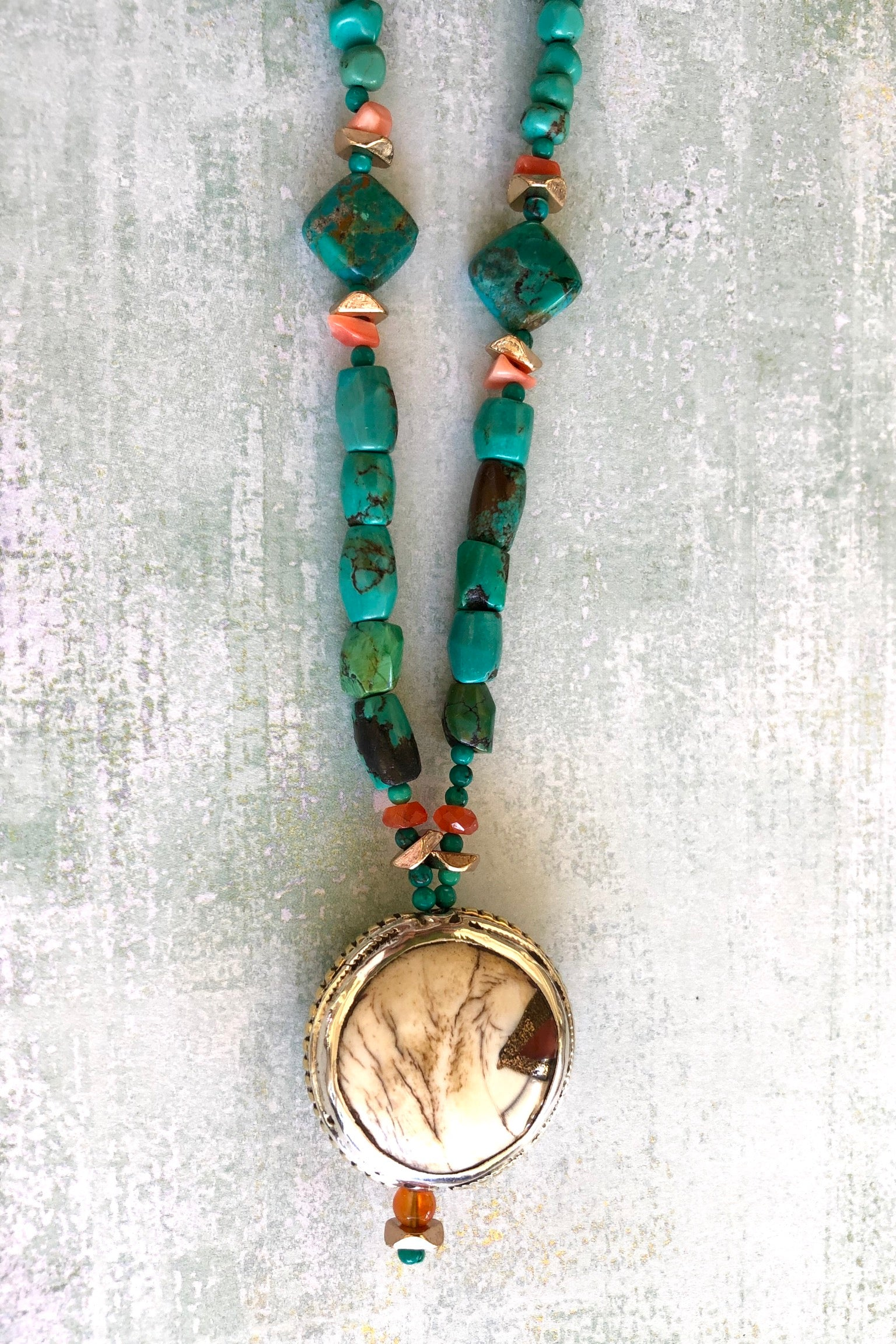 The centre piece is an inlaid Naga conch shell bead from Tibet. The beads are all genuine natural Turquoise, very irregular and some are very old.