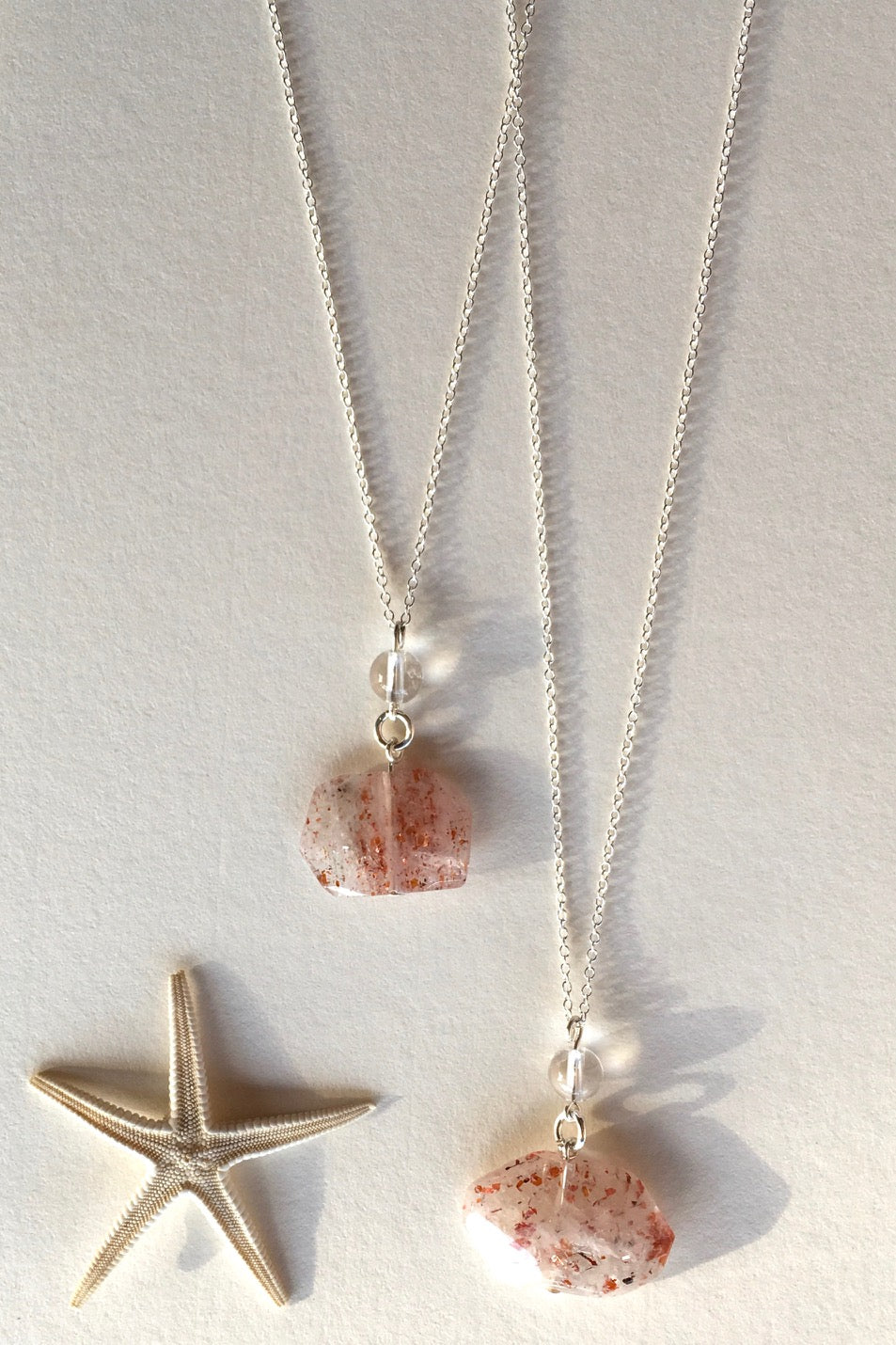 Pendant of Strawberry Quartz with Rock Crystal is unusual stone with flat cut and faceted to reveal all the lovely glittery inclusions hidden inside featuring 2.5cm to 3.5cm long total Each pendant drop.