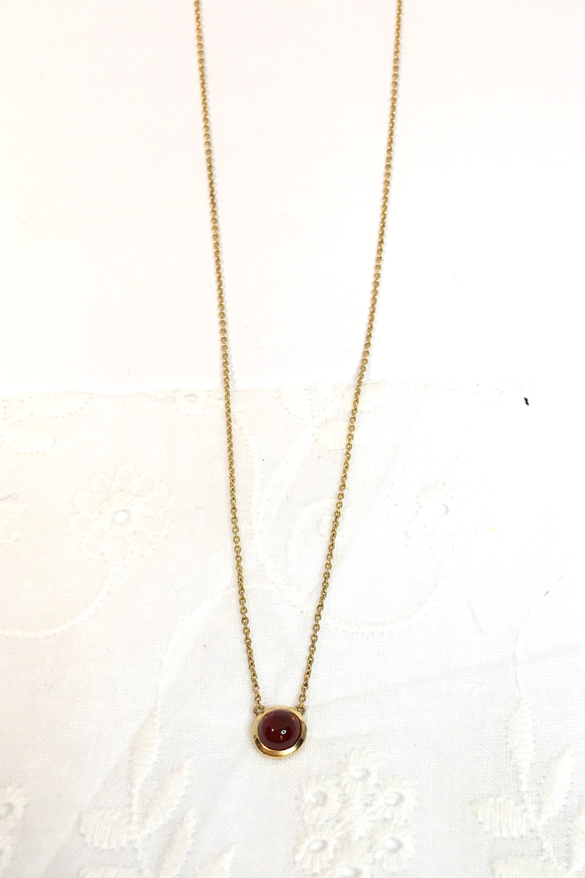 Vintage Pendant Garnet and Gold is a natural Garnet gemstone pendant featuring tiny round design and chain is 9ct gold plated onto 925 silver.