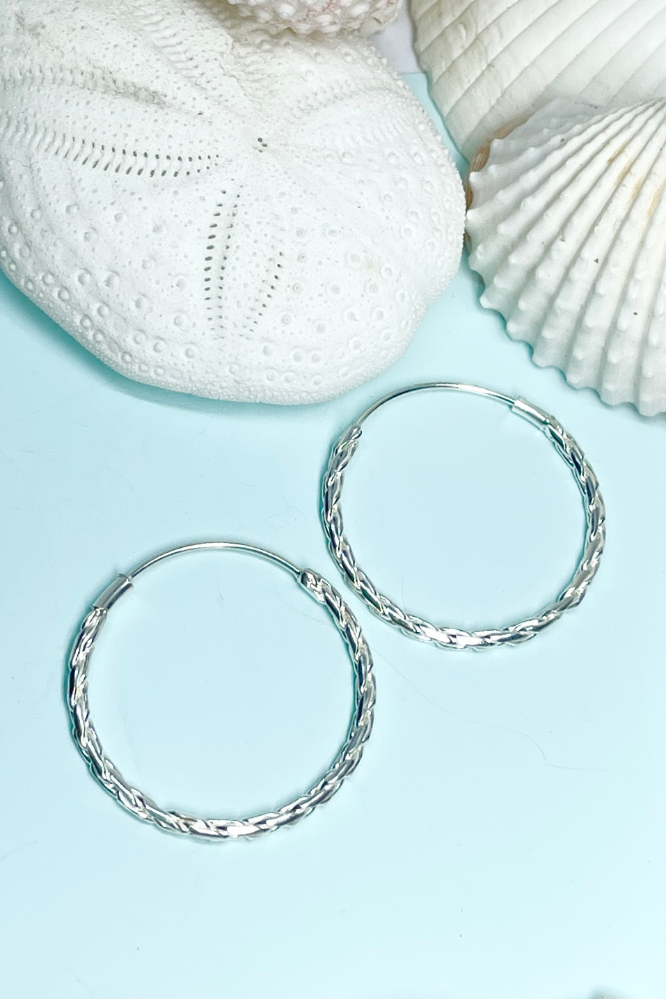 pretty Silver hoop earrings. Not too big or too small just perfect. The hoop has a textured finish