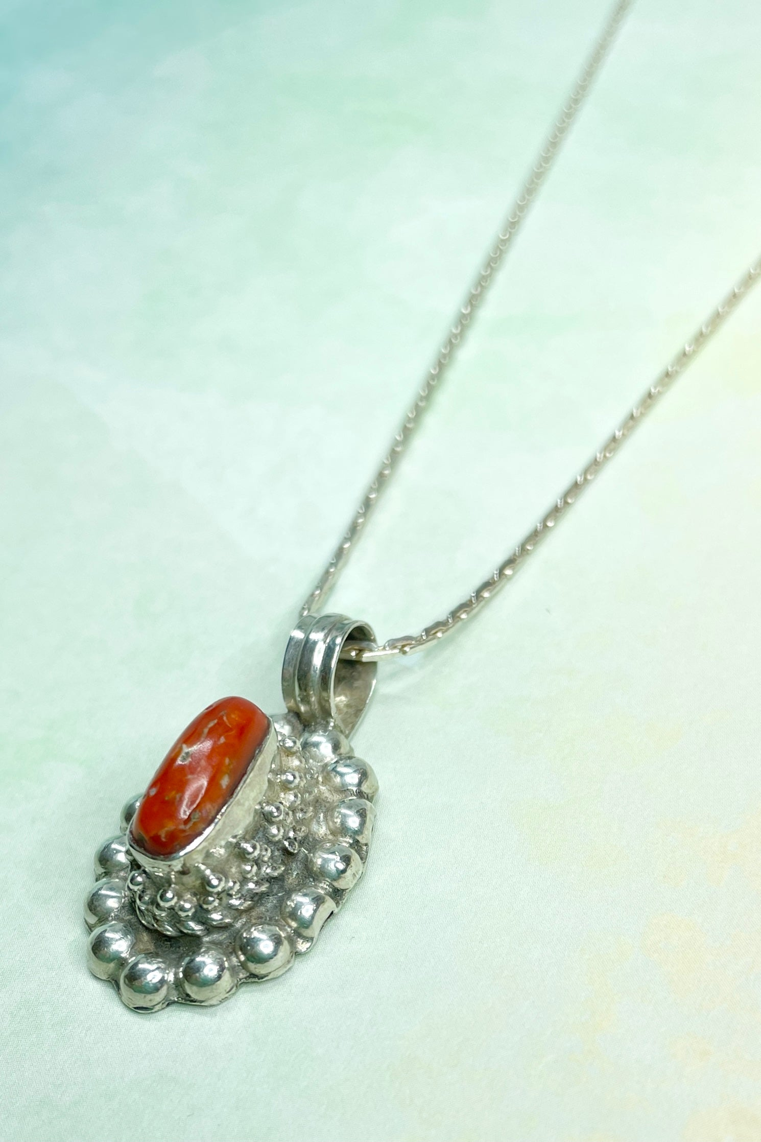 "This Red Coral Vintage Pendant  High Set is an old piece that has a ""village make"" feel to it. Set in 925 silver"